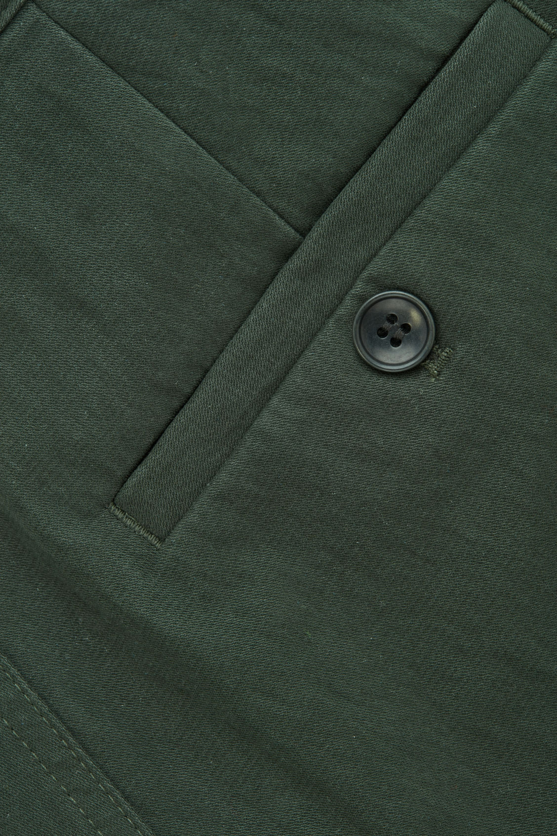Side image of Cos relaxed button-up chinos in green