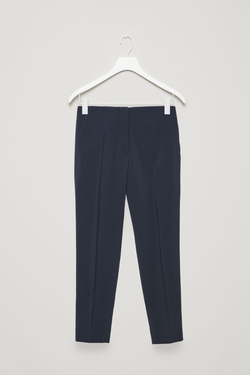 Front image of Cos straight pressfold trousers in blue