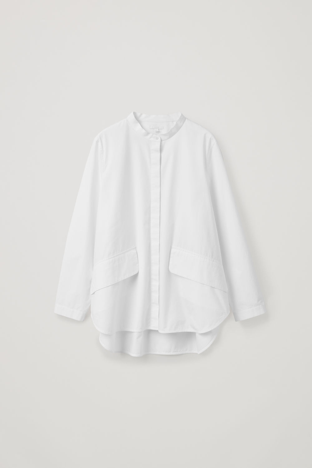 VOLUMINOUS SHIRT WITH POCKETS