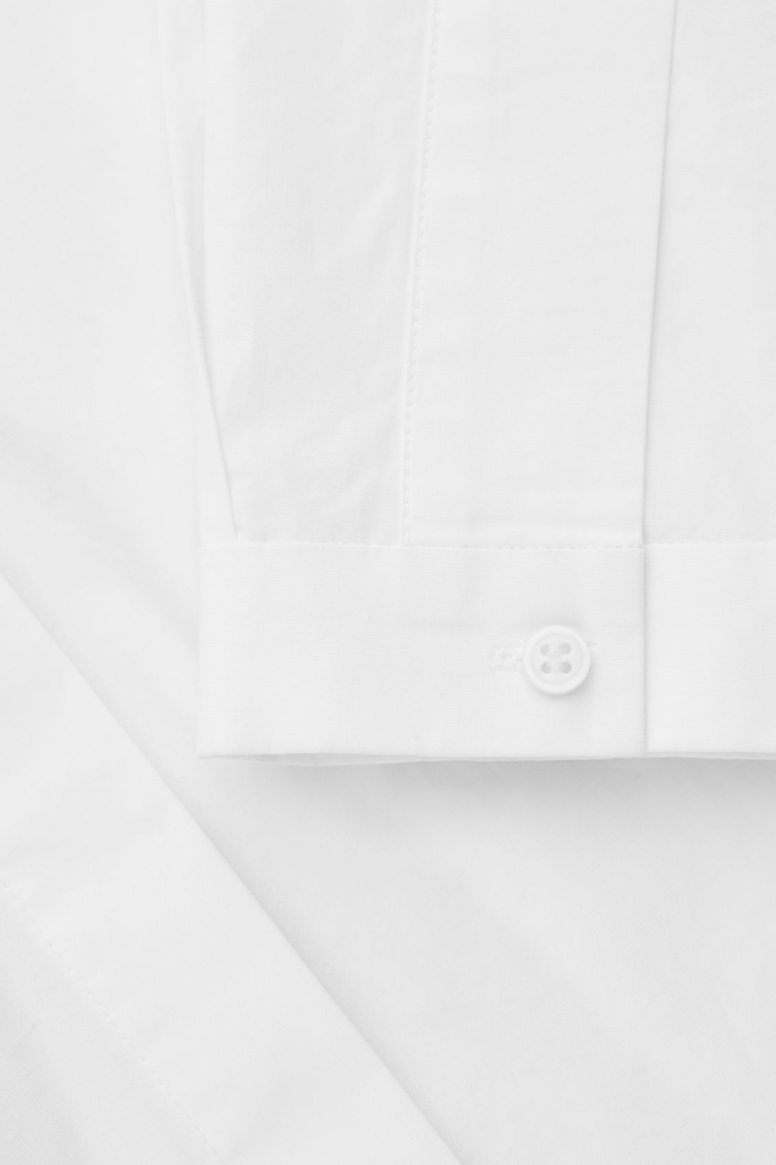 Side image of Cos voluminous shirt with pockets in white
