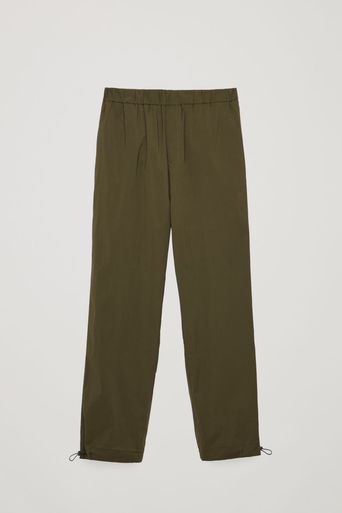 Front image of Cos light elasticated trousers in green