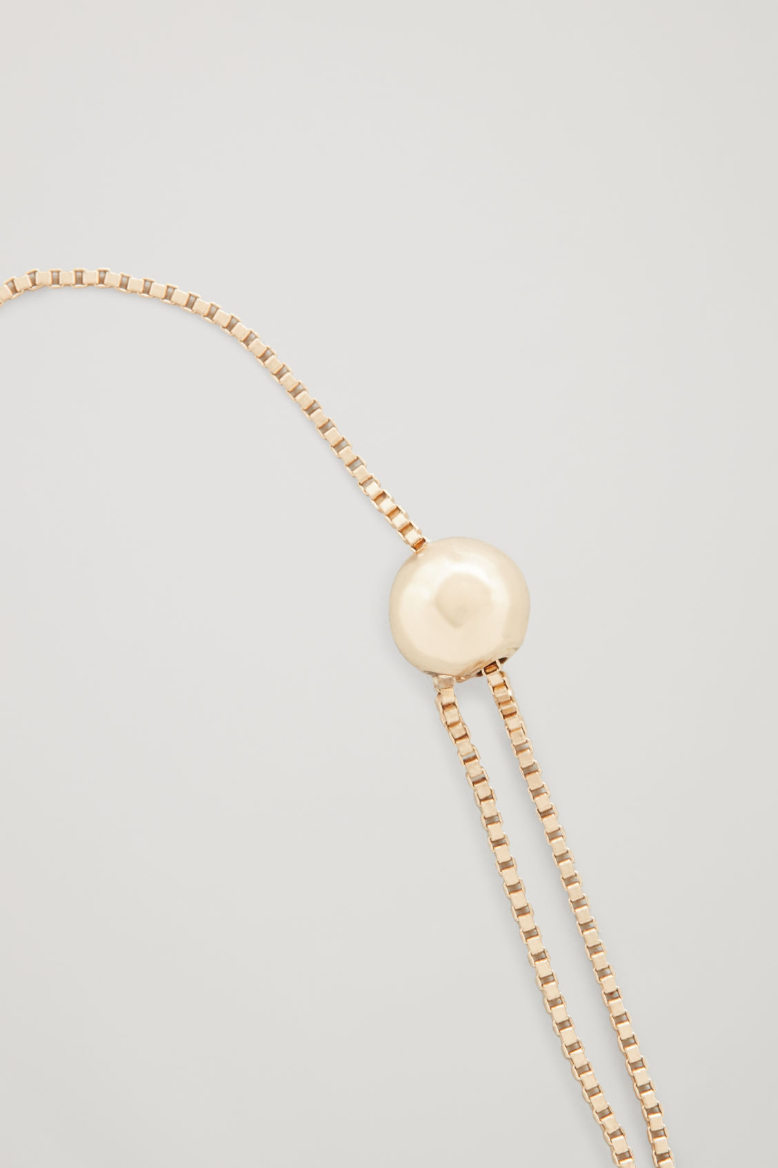 Side image of Cos ball-detail chain bracelet  in gold