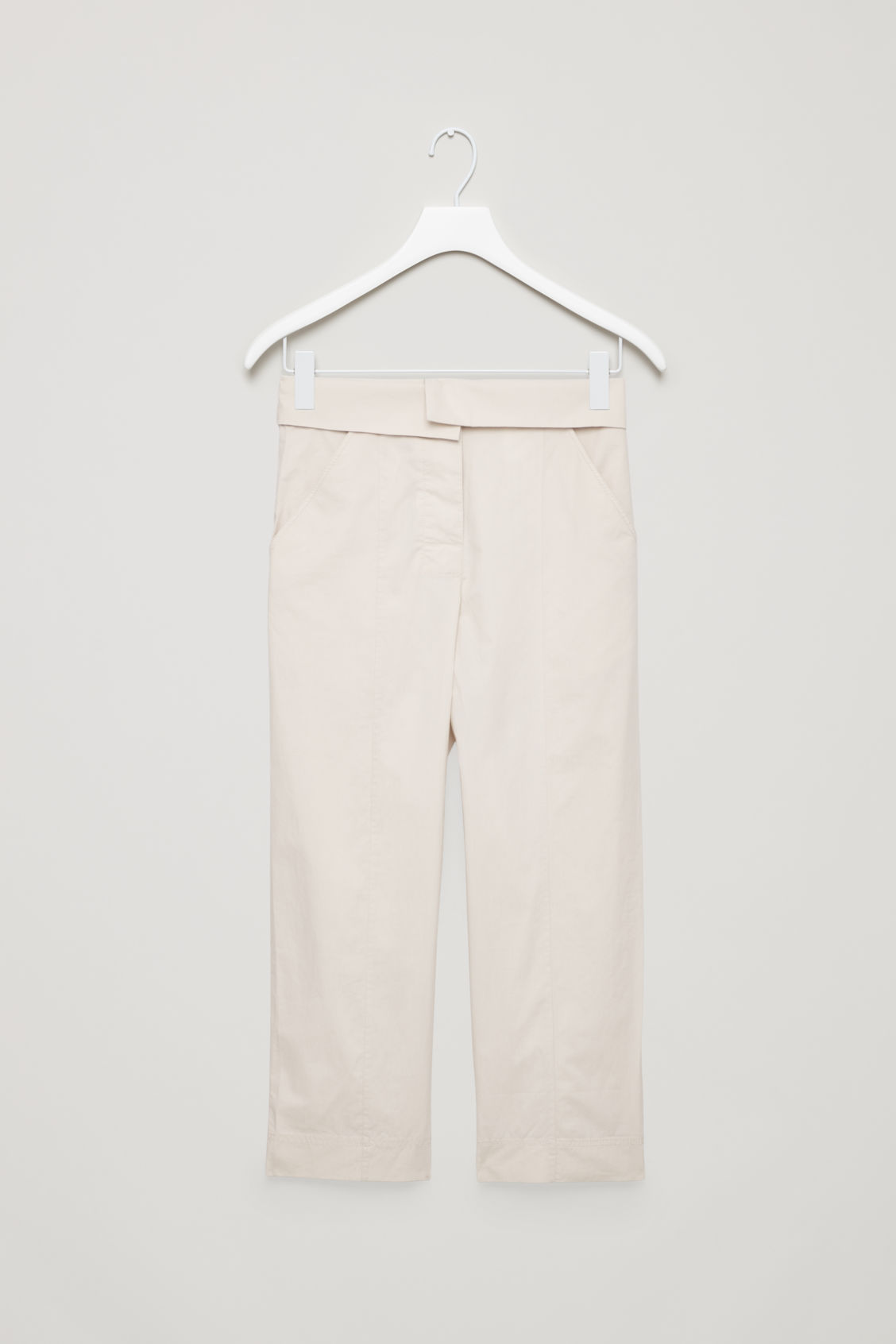Front image of Cos trousers with folded waistband in beige