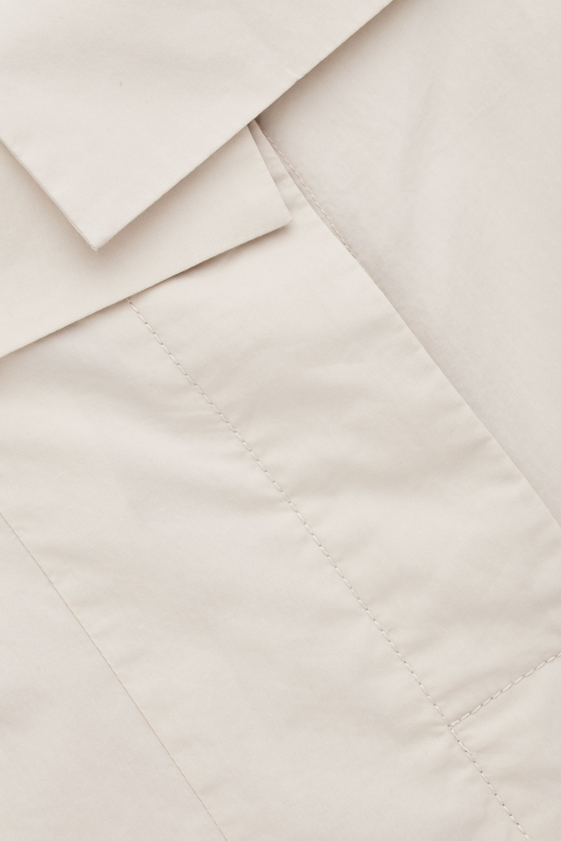 Side image of Cos trousers with folded waistband in beige