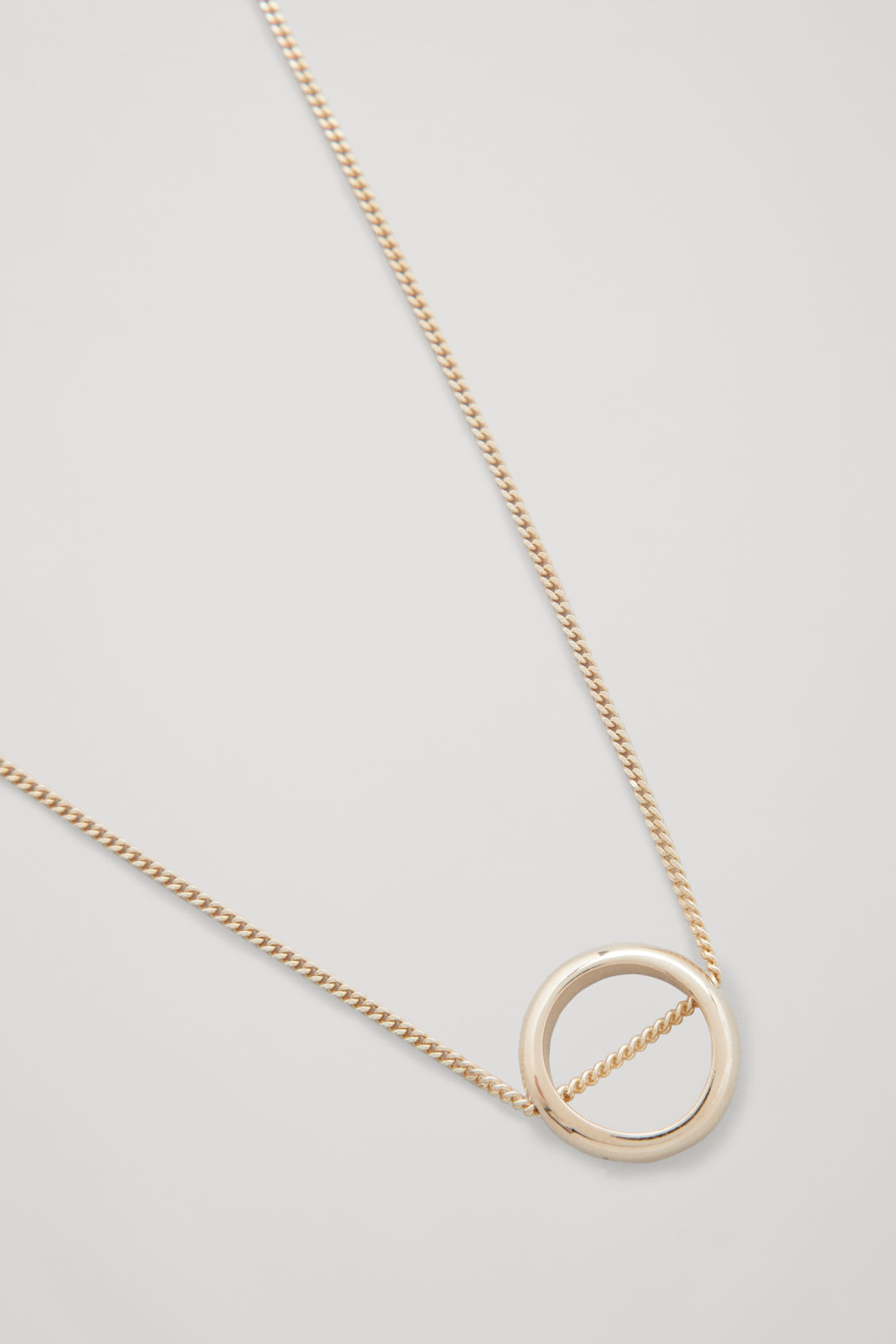 Side image of Cos gold-plated pendant necklace in gold
