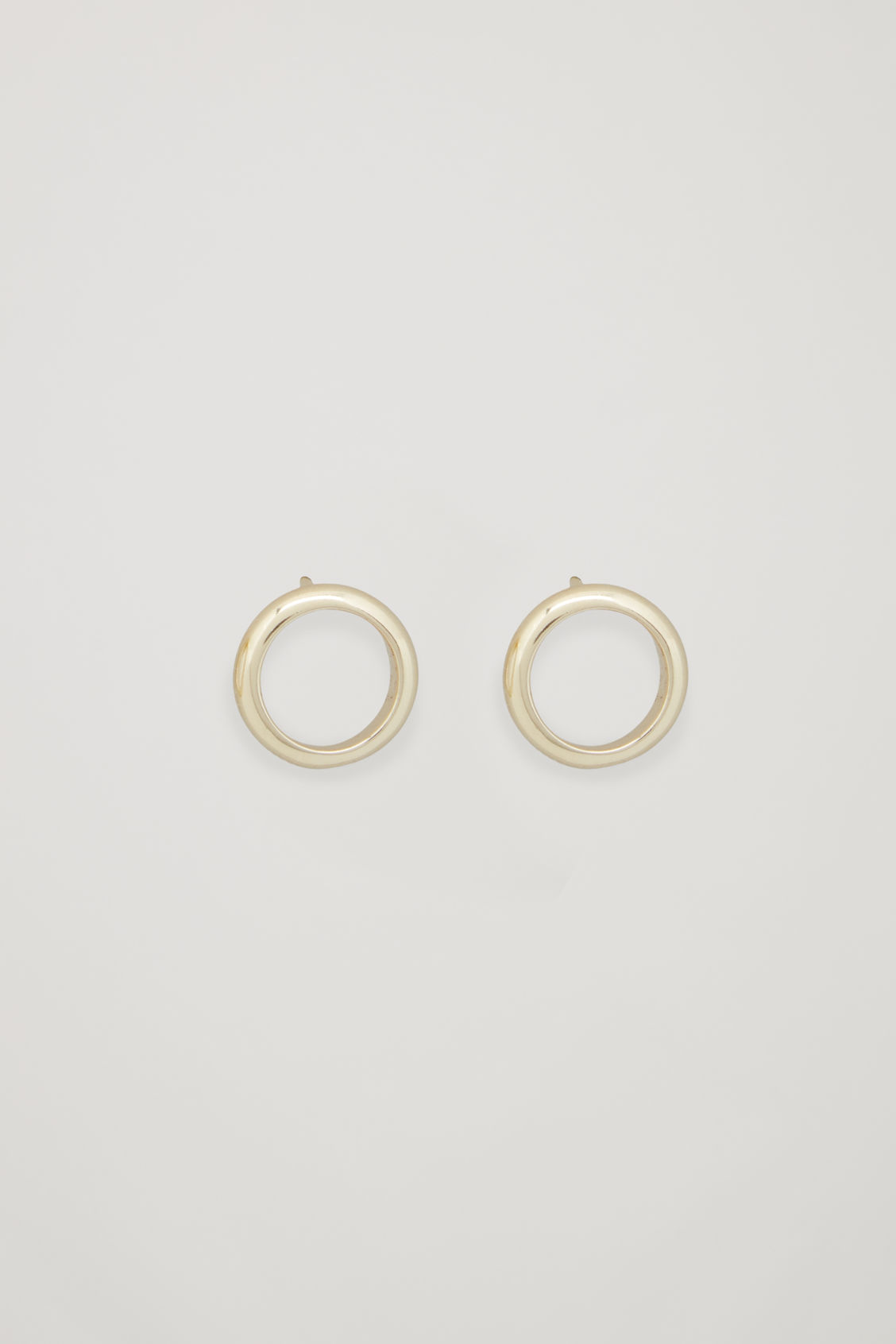 Front image of Cos gold-plated stud earrings in gold