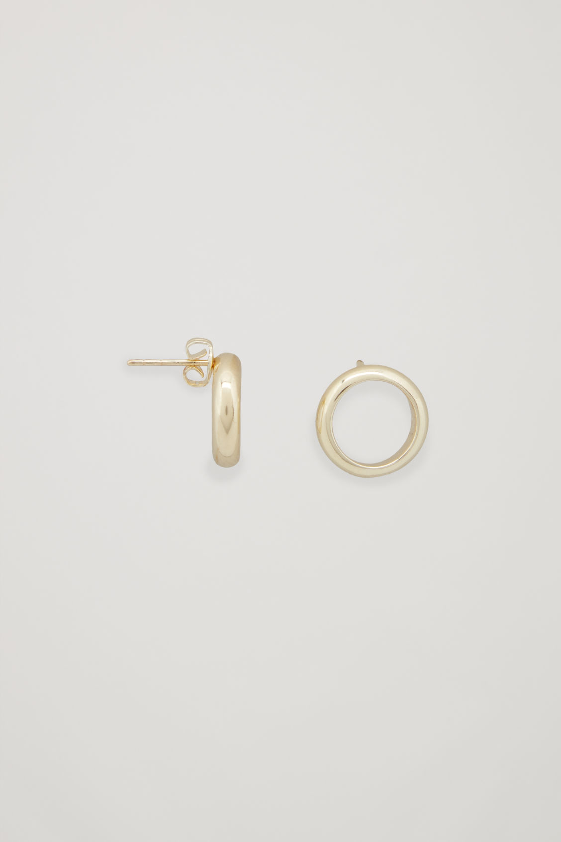 Side image of Cos gold-plated stud earrings in gold