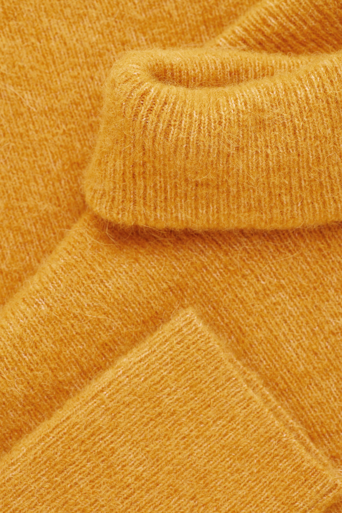 Side image of Cos alpaca-blend tunic jumper in yellow