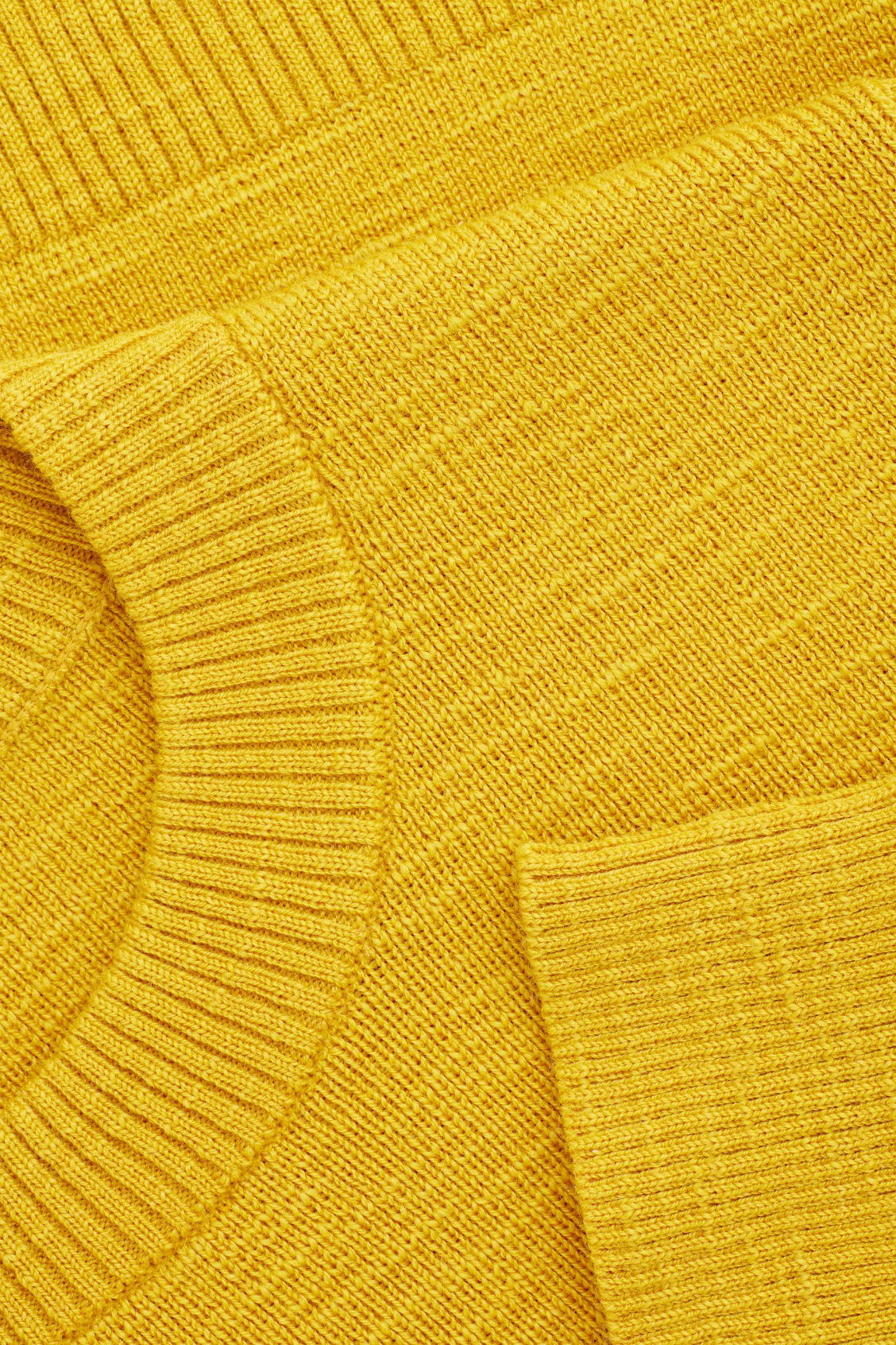 Side image of Cos ribbed merino-wool jumper in yellow
