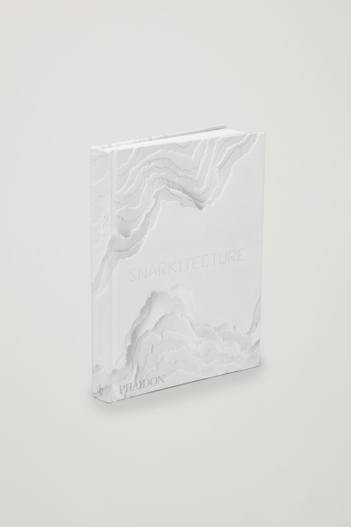 Side image of Cos snarkitecture in white
