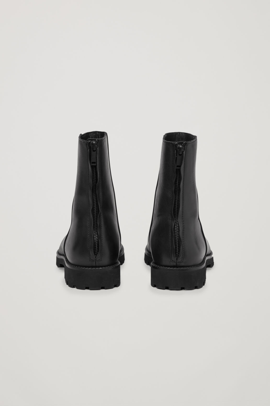 Side image of Cos chunky-sole leather boots in black