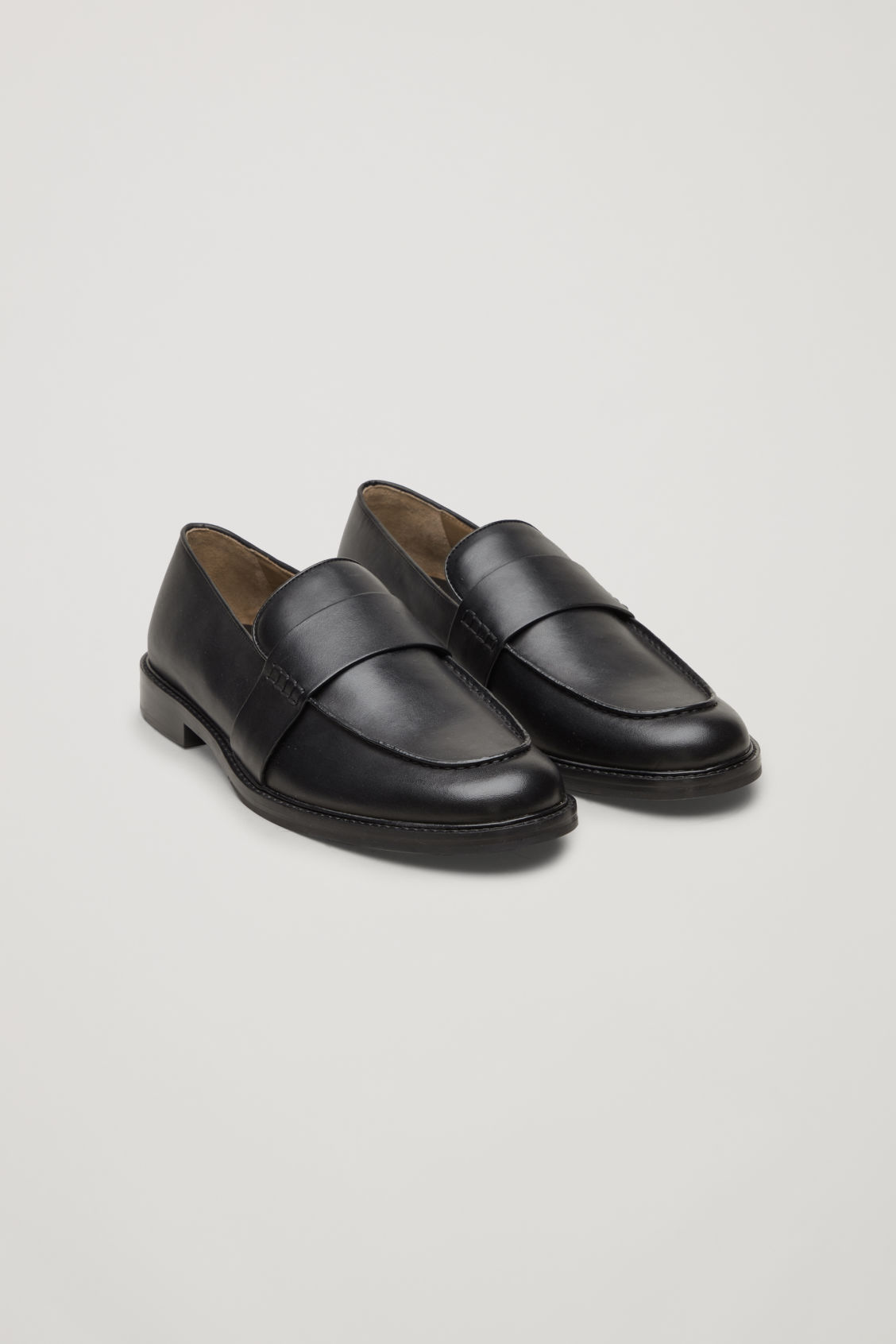 97551d4eebc Front image of Cos leather penny loafers in black