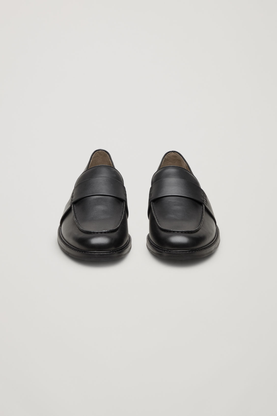 Side image of Cos leather penny loafers in black