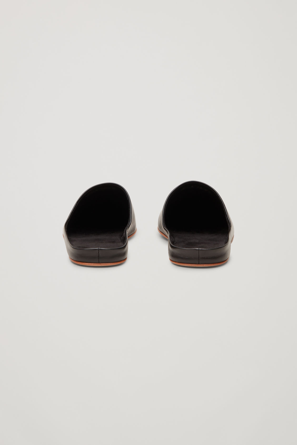 Side image of Cos leather slippers in black