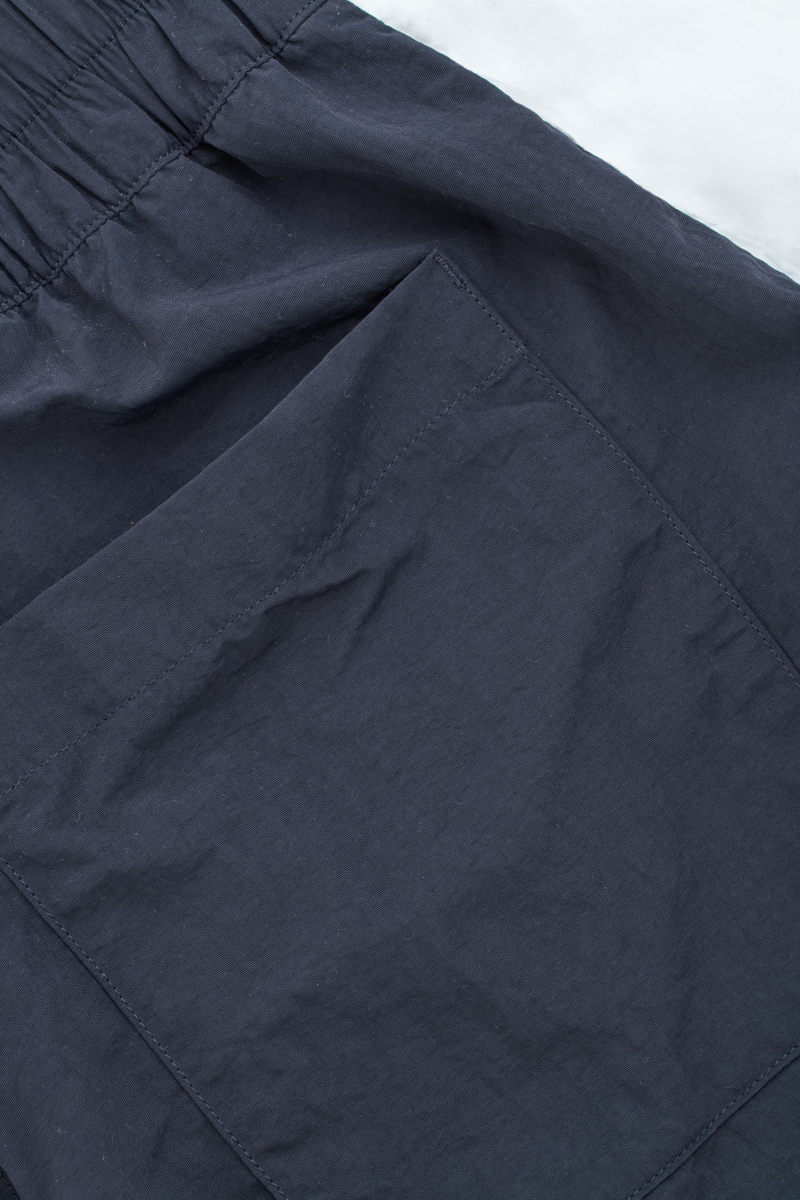 Side image of Cos slim-fit swim shorts in blue