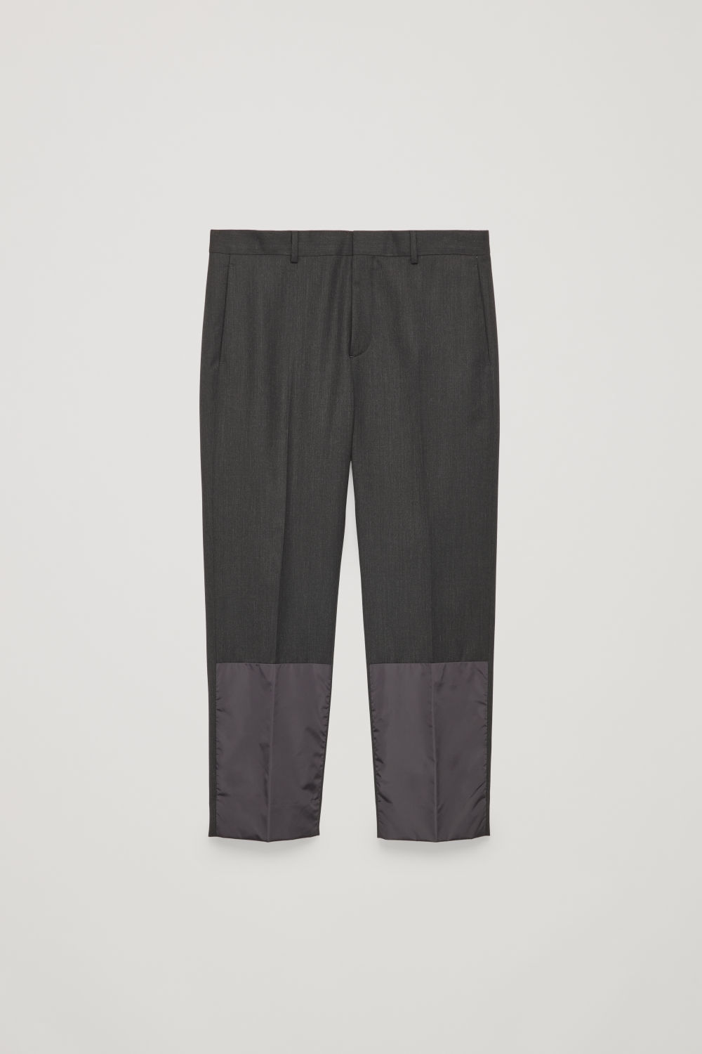 Front image of Cos cropped trousers with patches in grey