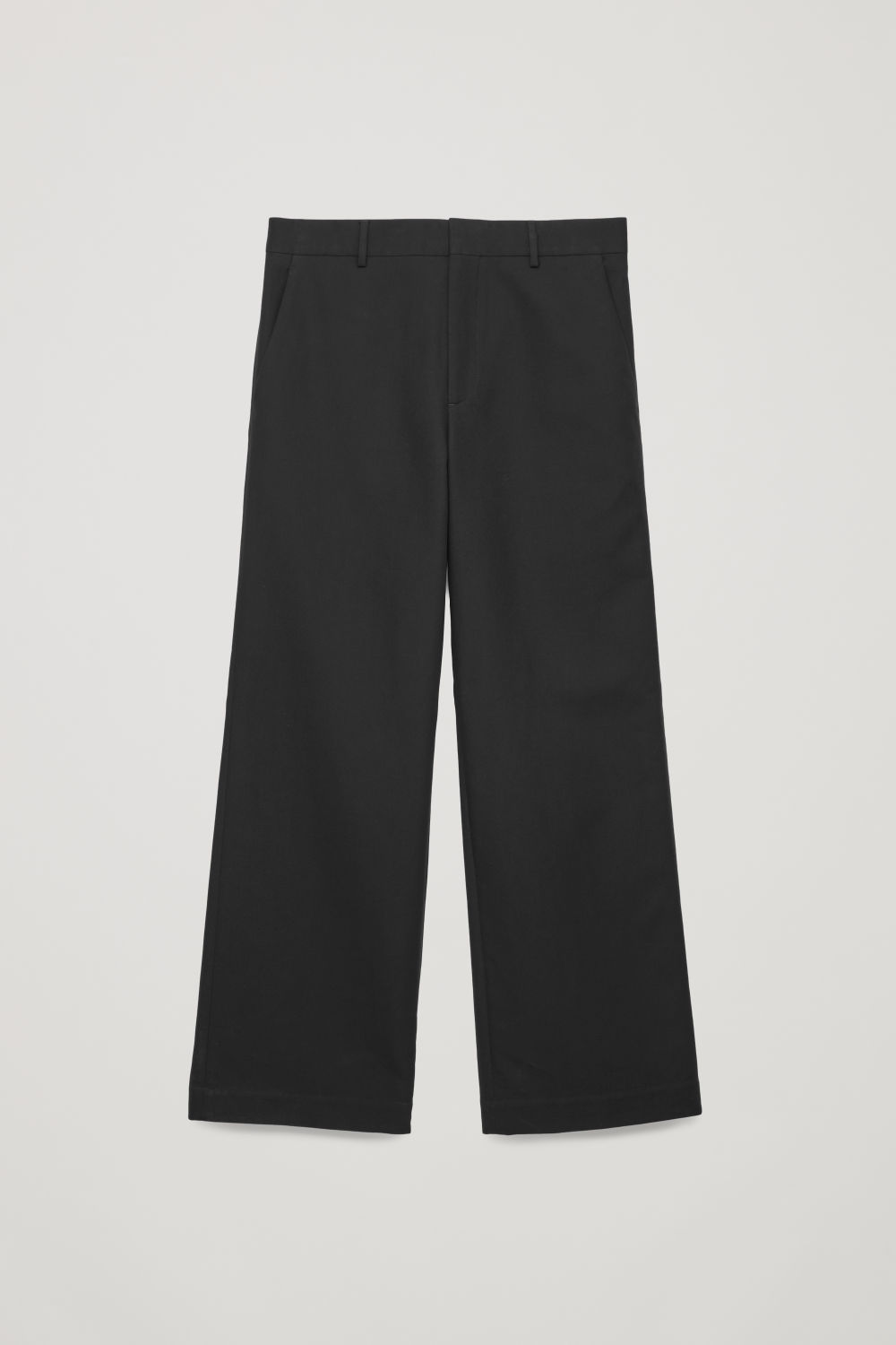 Front image of Cos flared cotton-wool trousers in black