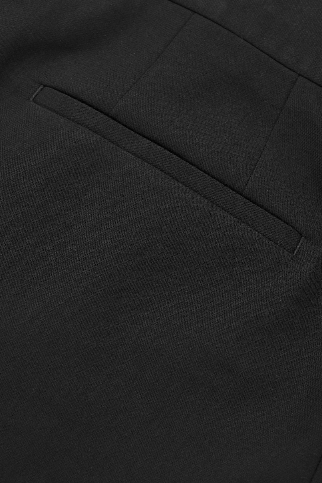 Side image of Cos flared cotton-wool trousers in black