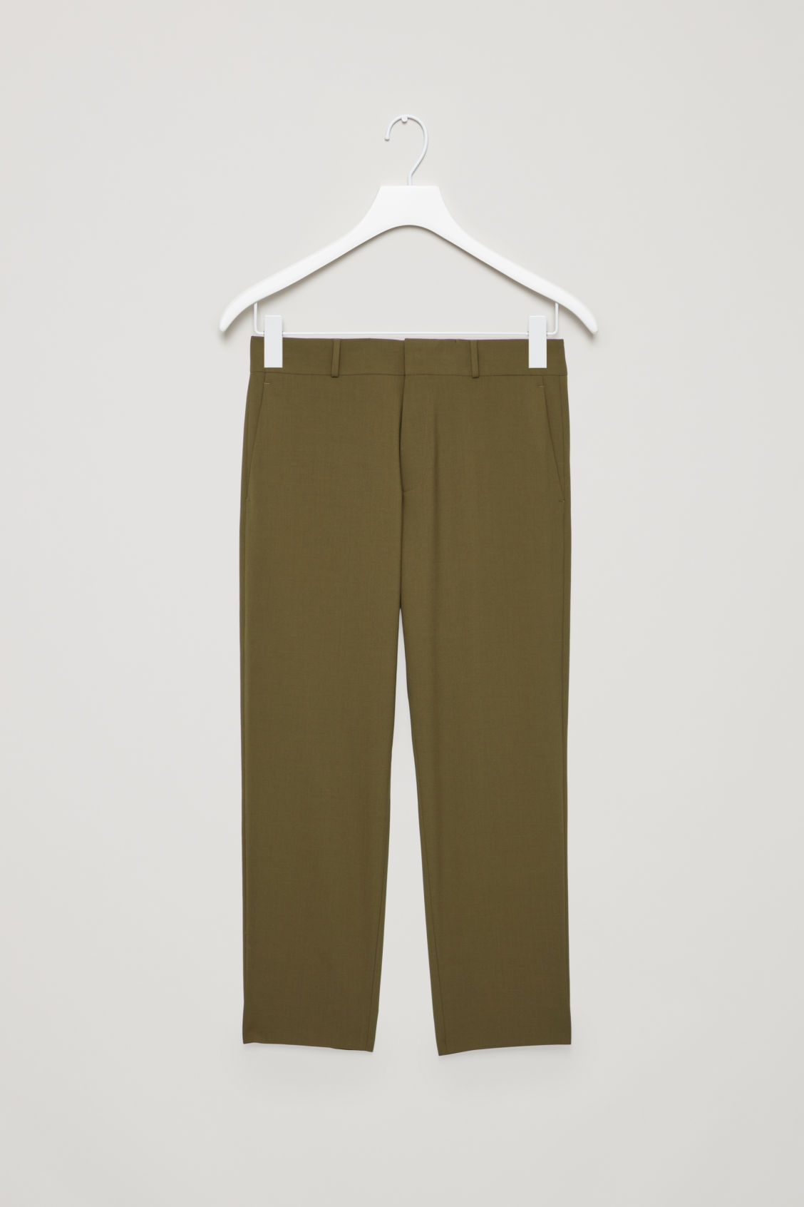 Front image of Cos cropped wool trousers in green