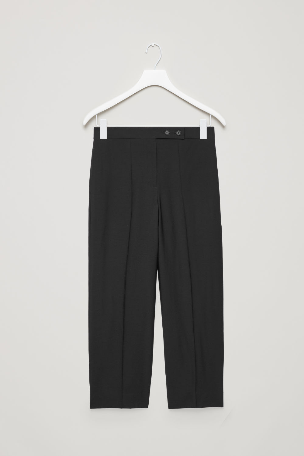 Front image of Cos buttoned straight-leg trousers in black