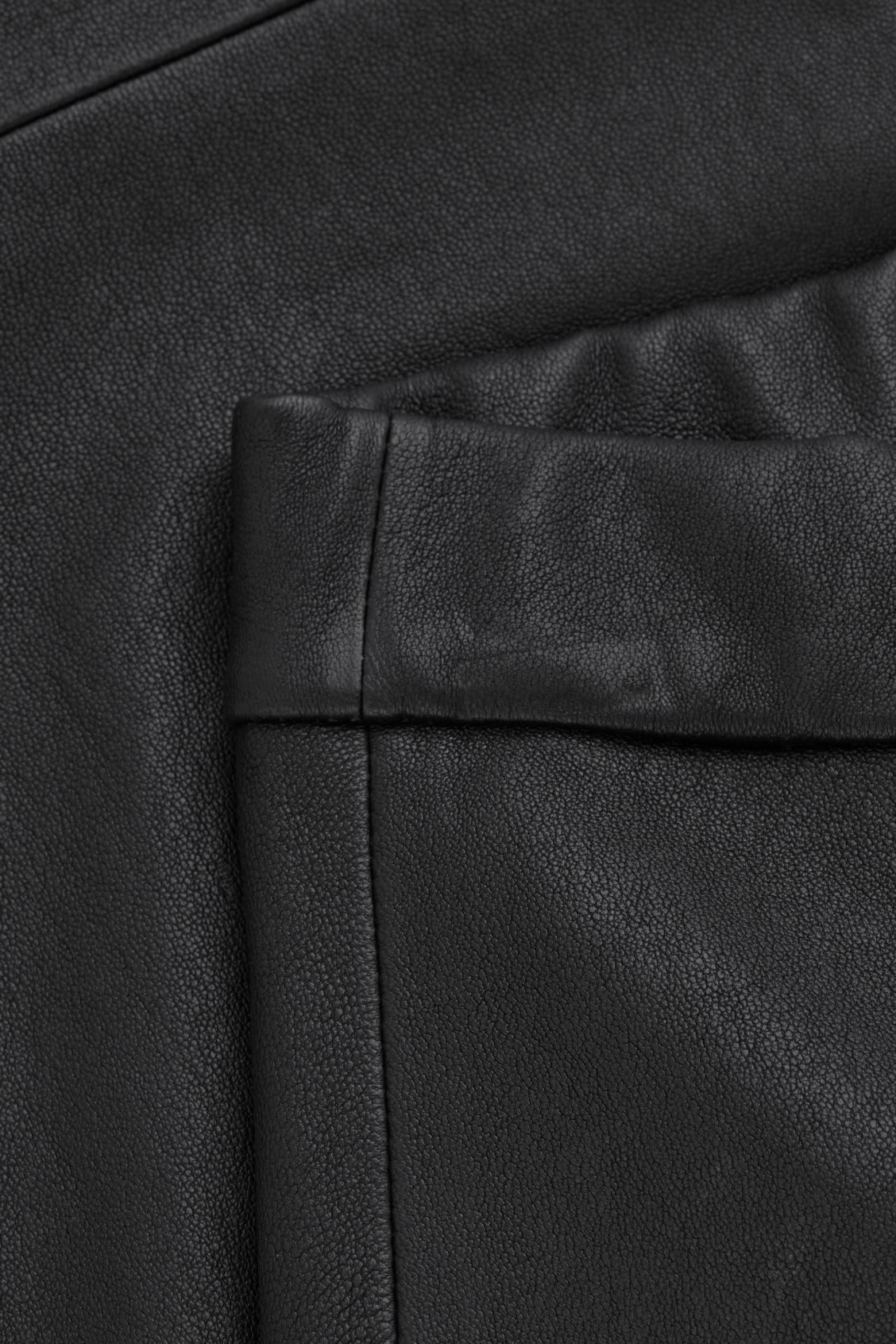 Side image of Cos leather leggings in black