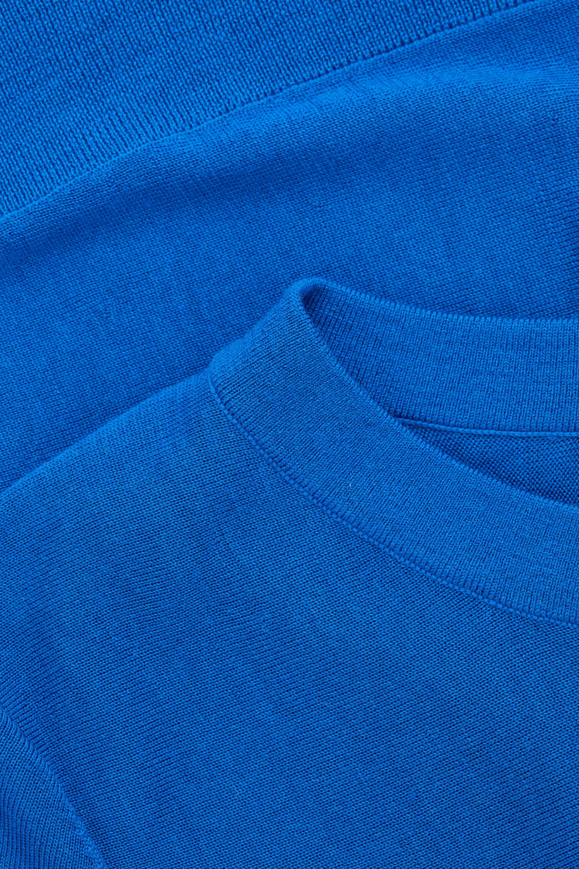 Side image of Cos belted a-line wool jumper  in blue