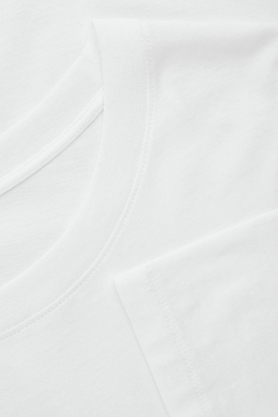 Side image of Cos cotton long-sleeved top in white