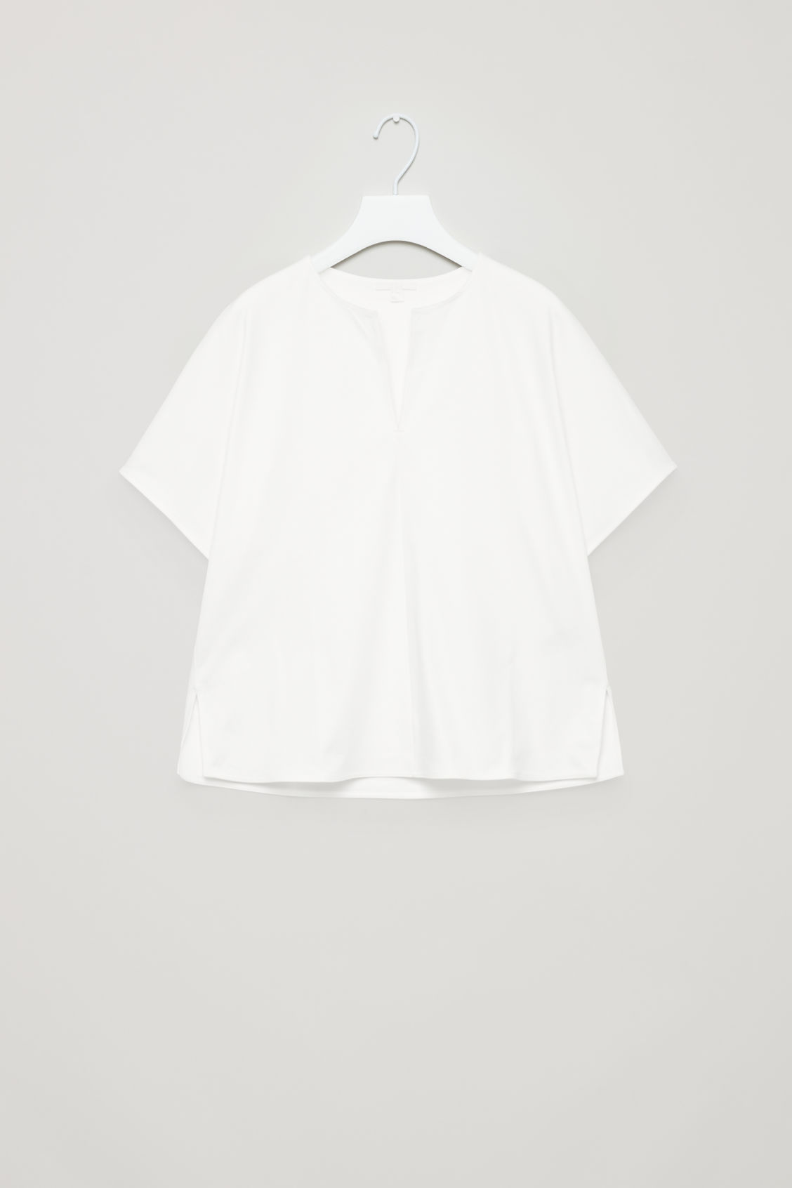 Front image of Cos slit-neck jersey top in white