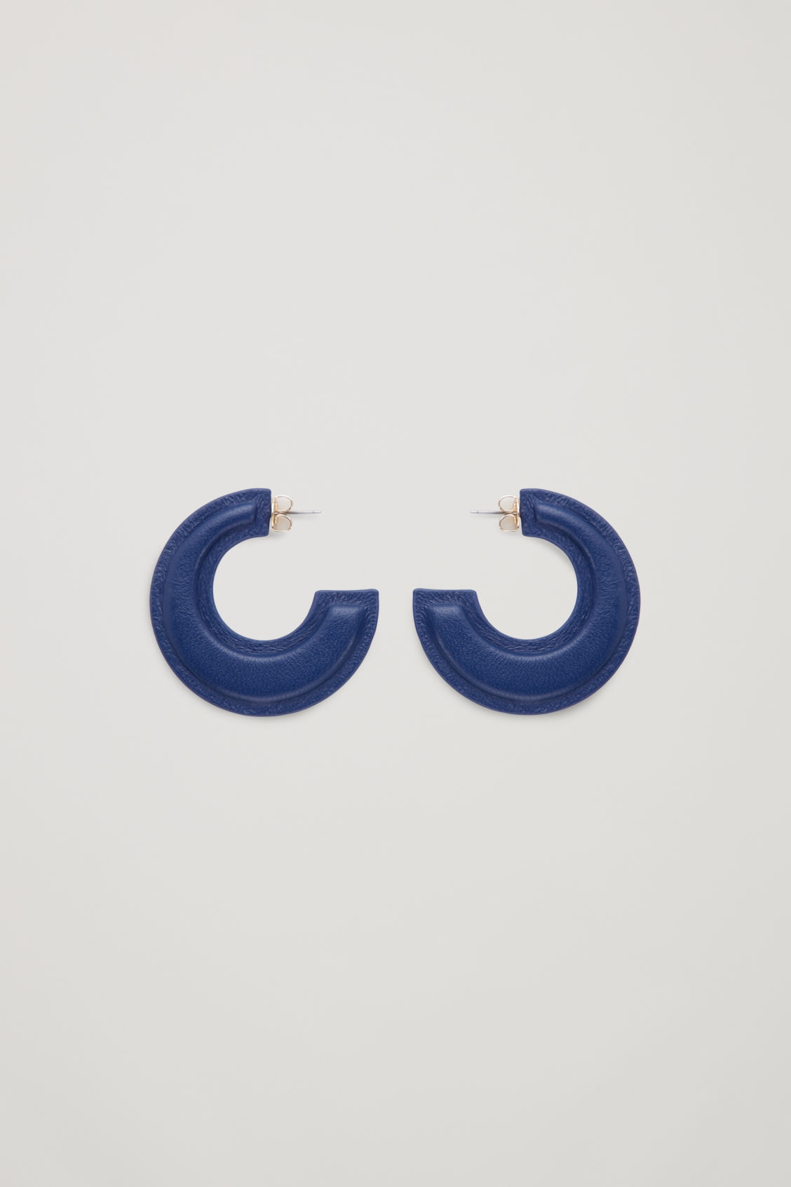 Front image of Cos padded two-tone leather hoops in blue