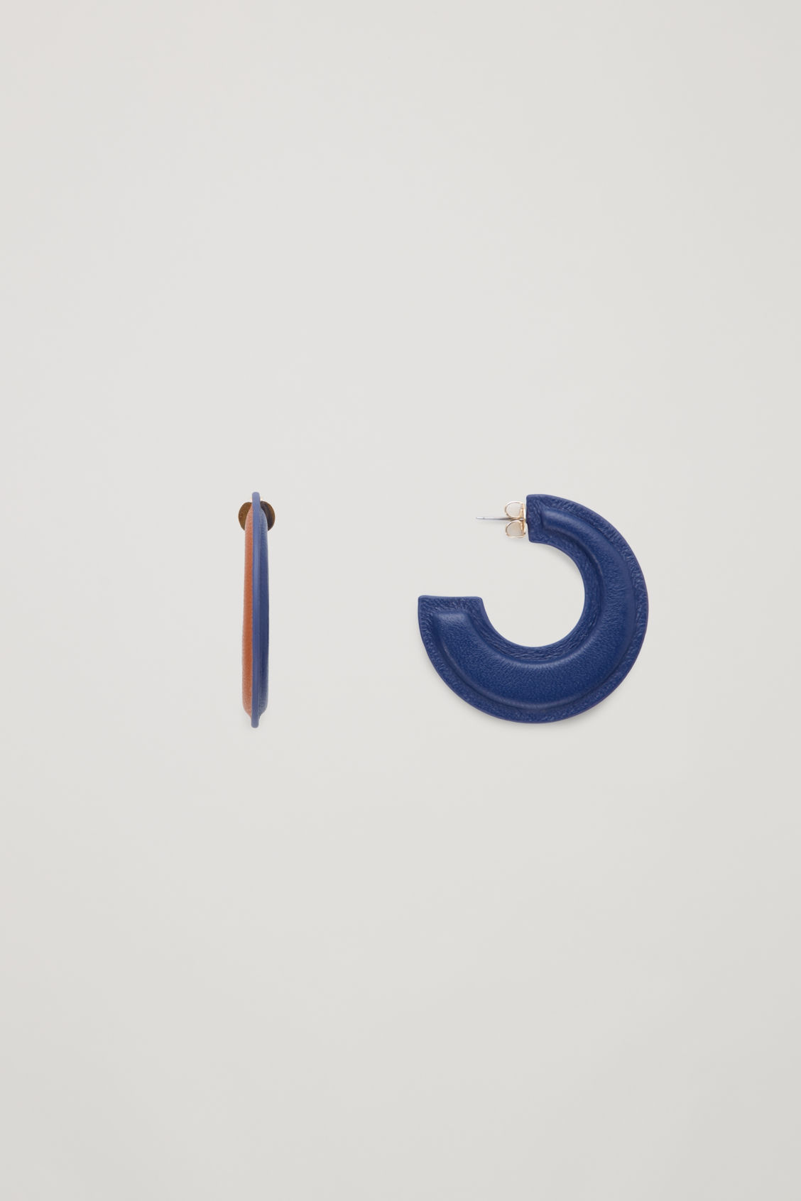 Side image of Cos padded two-tone leather hoops in blue