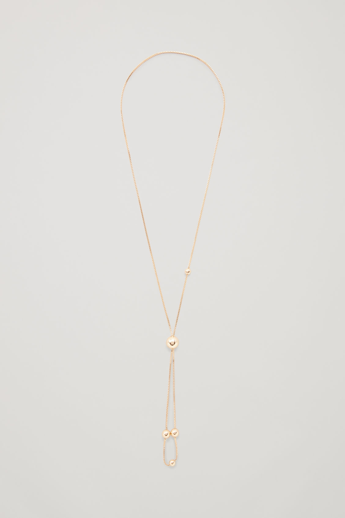 Front image of Cos long chain necklace with balls in gold