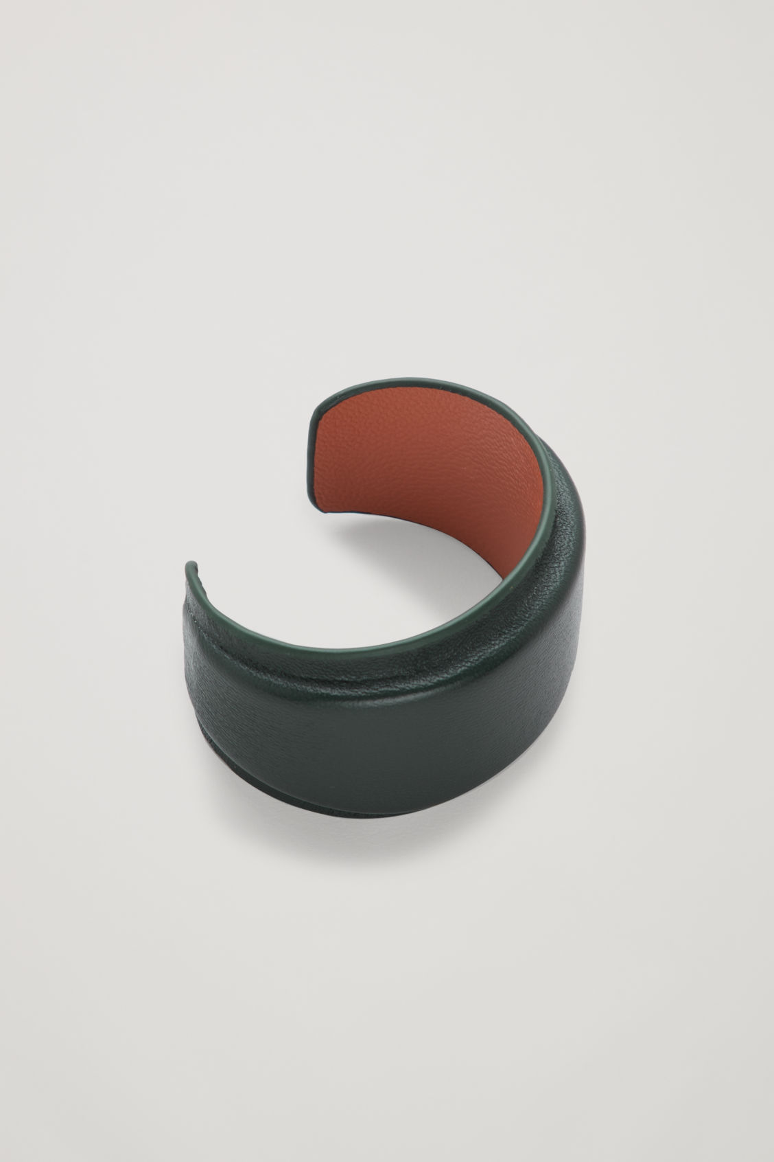 Side image of Cos padded two-tone leather cuff in green