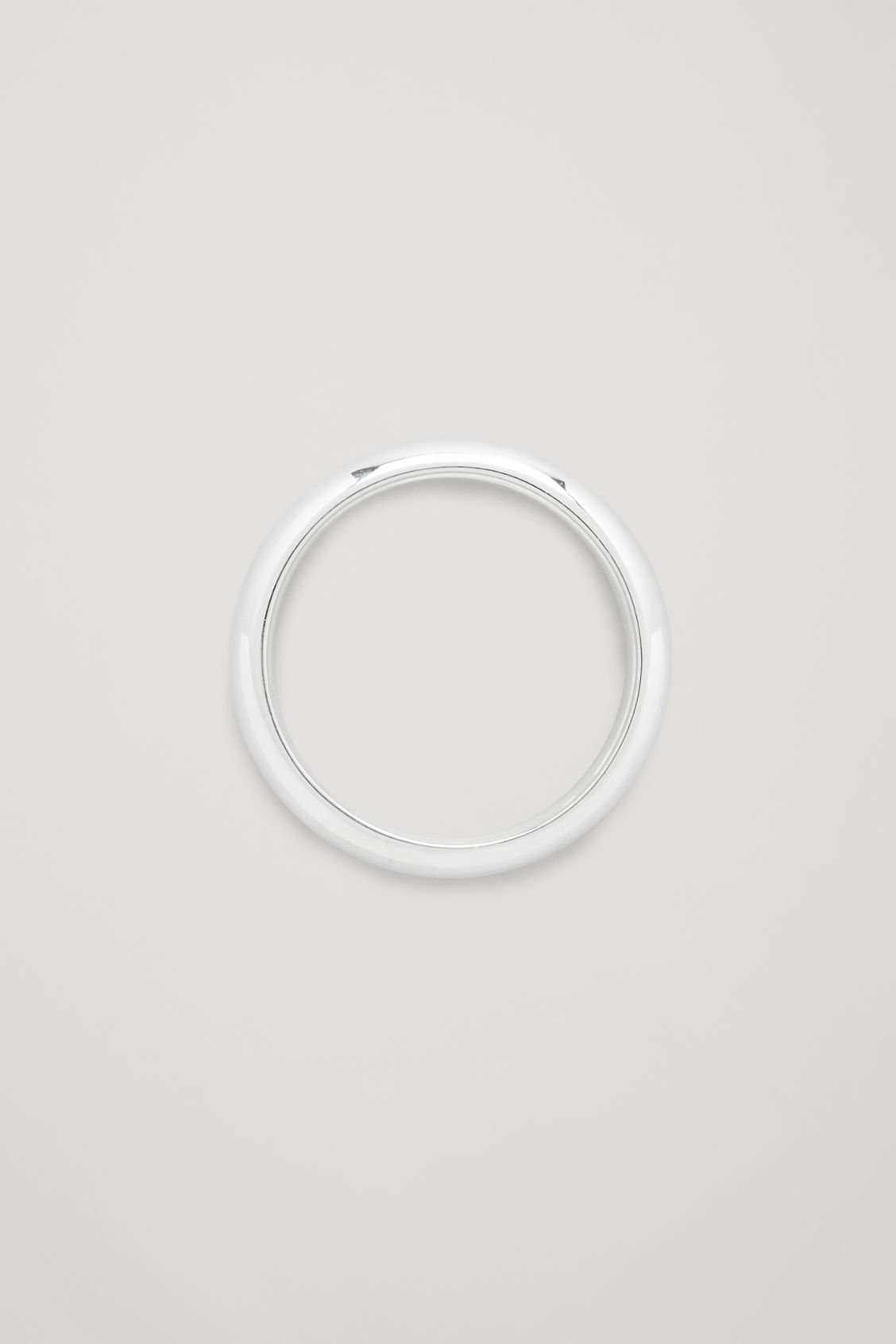 Front image of Cos curved sterling silver ring in silver