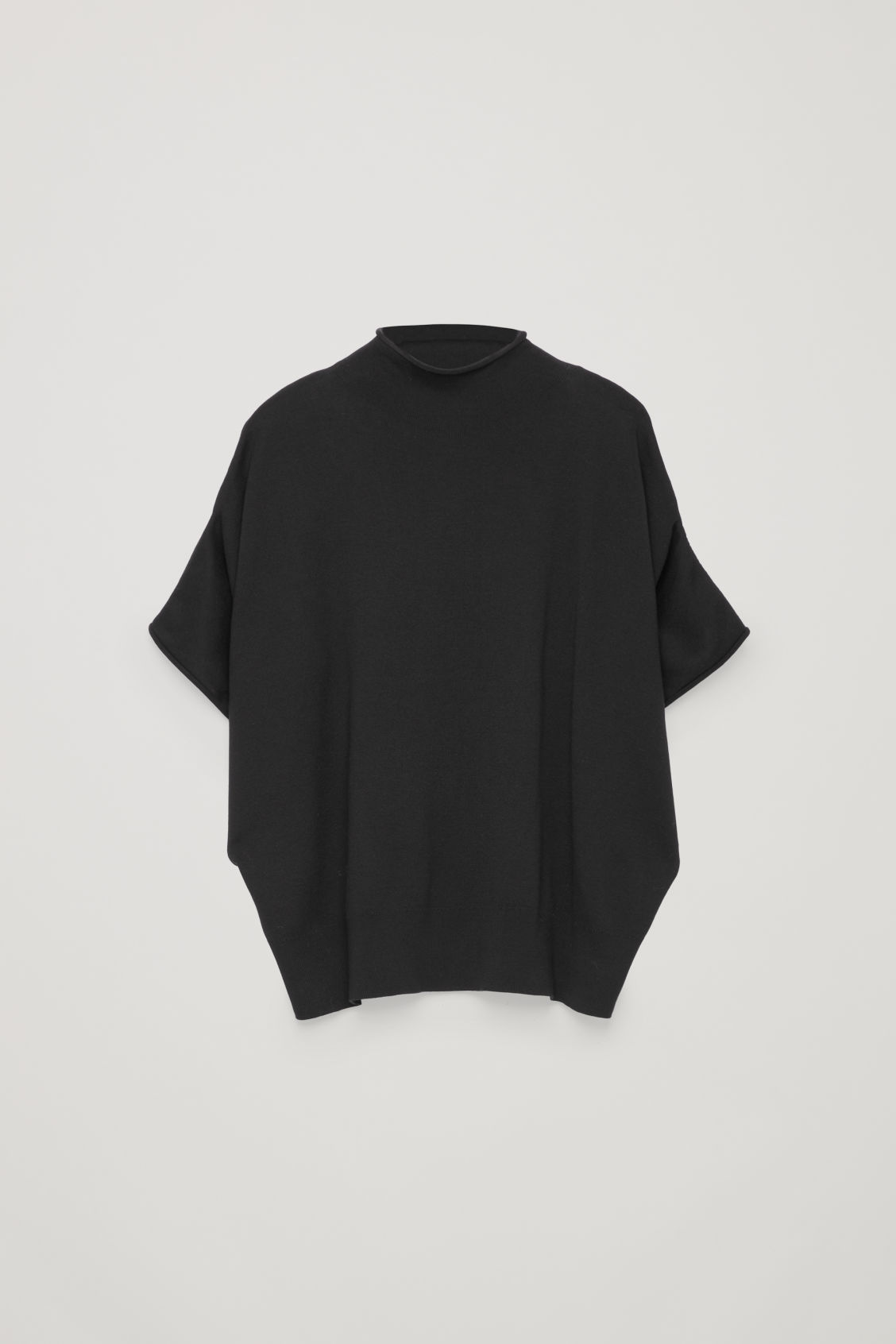 Front image of Cos voluminous knitted top in black