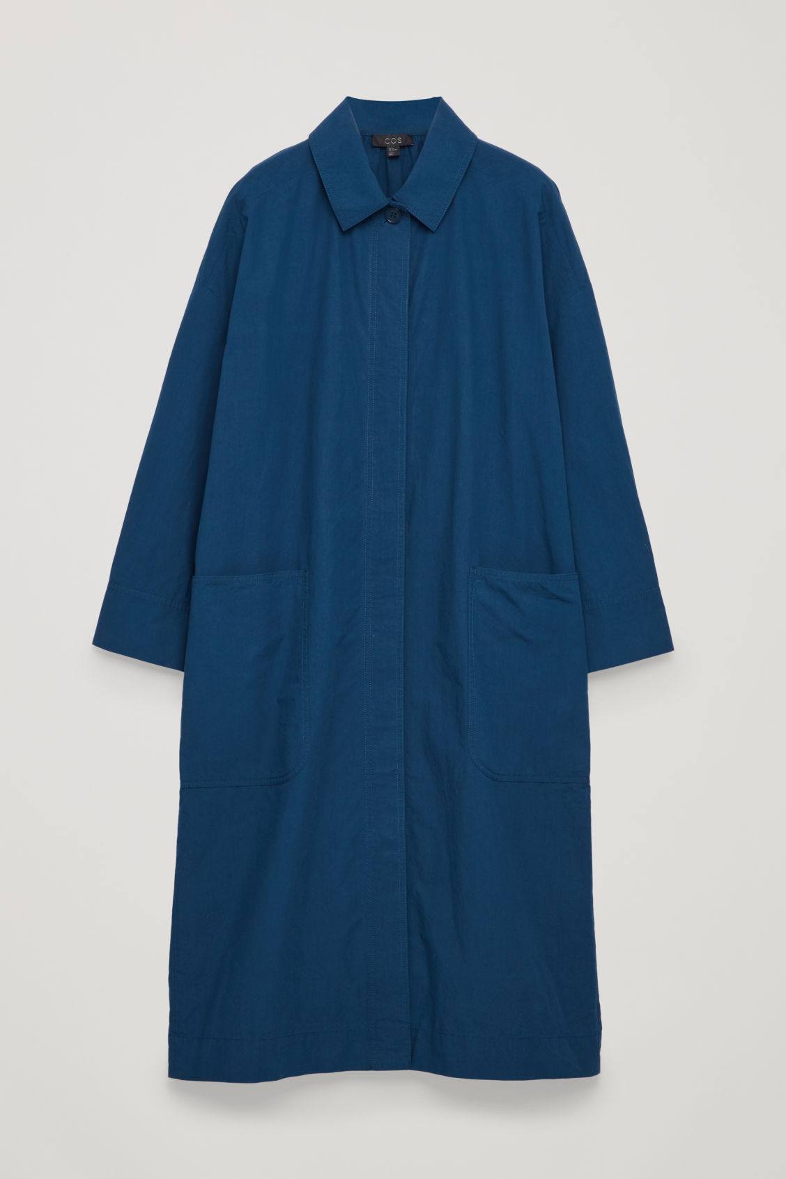Front image of Cos long jacket with gathered back in blue