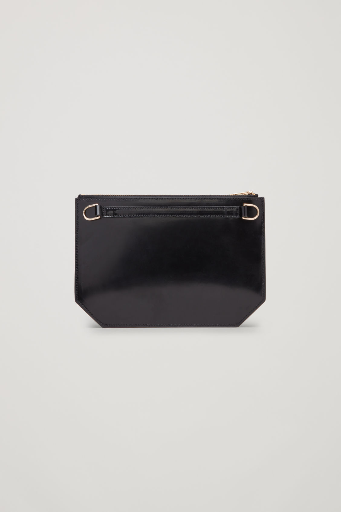 Side image of Cos multifunctional leather bag in black