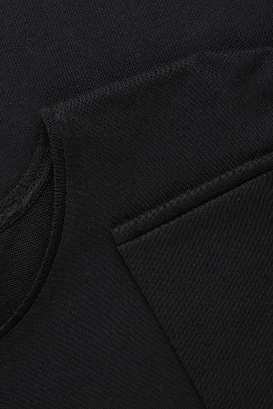 Side image of Cos jersey top with bound details in black