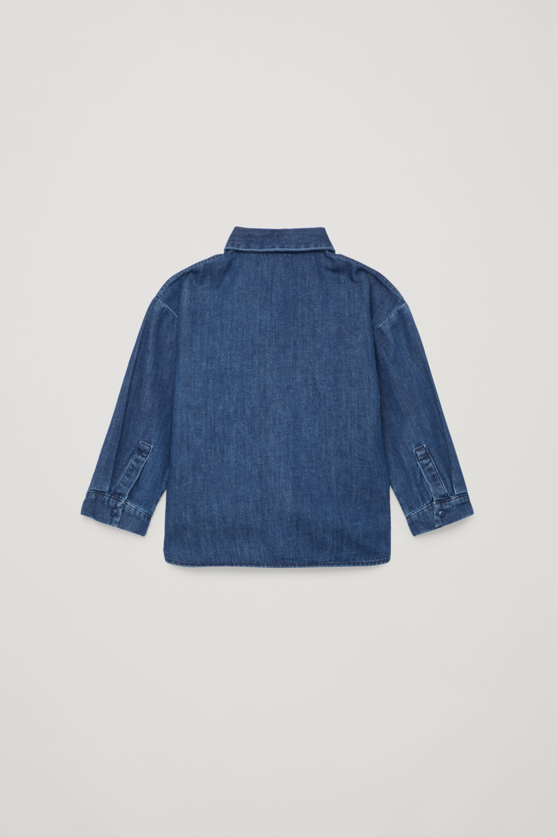 Side image of Cos denim shirt with fake pocket in blue