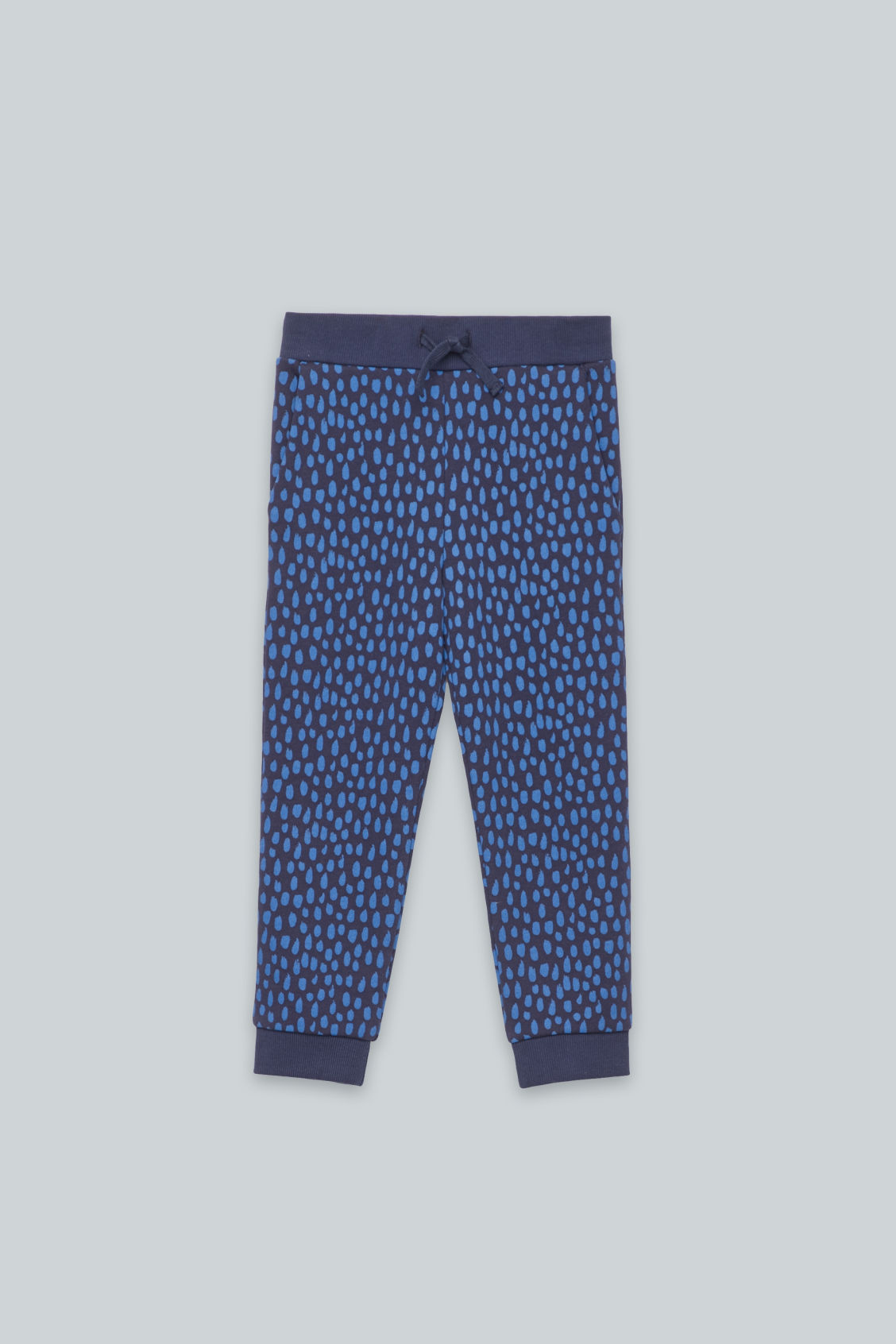 Front image of Cos printed jersey trousers in blue