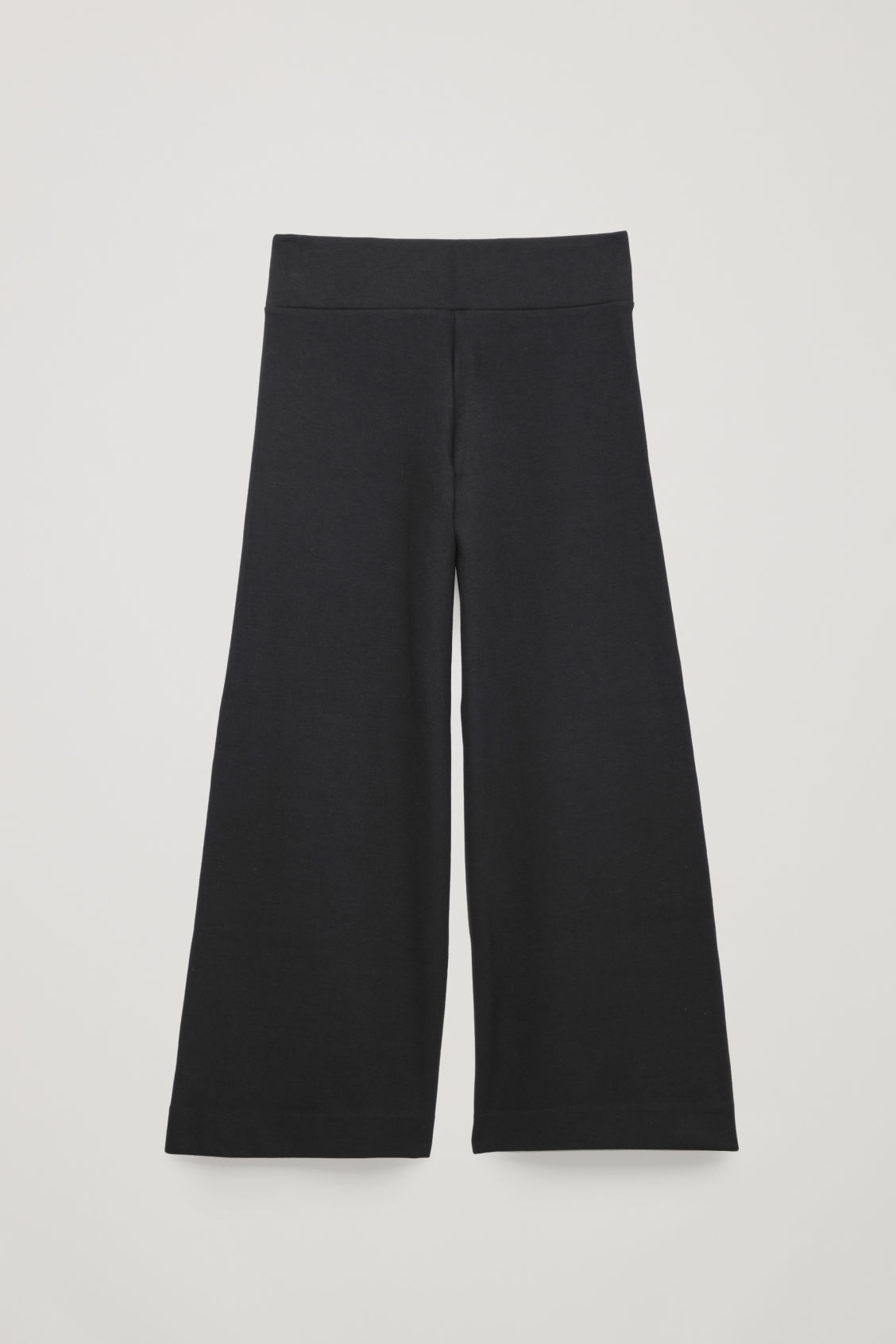 Front image of Cos ribbed stretch-cotton trousers in black