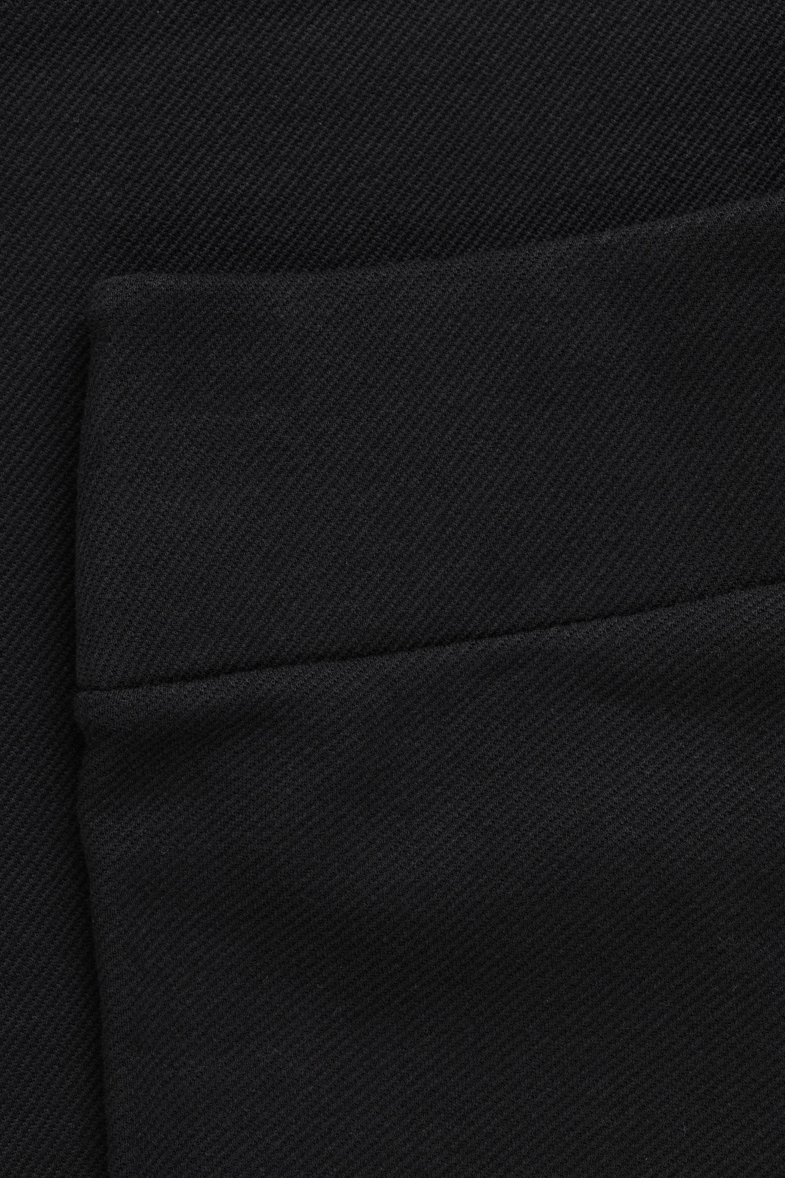 Side image of Cos ribbed stretch-cotton trousers in black