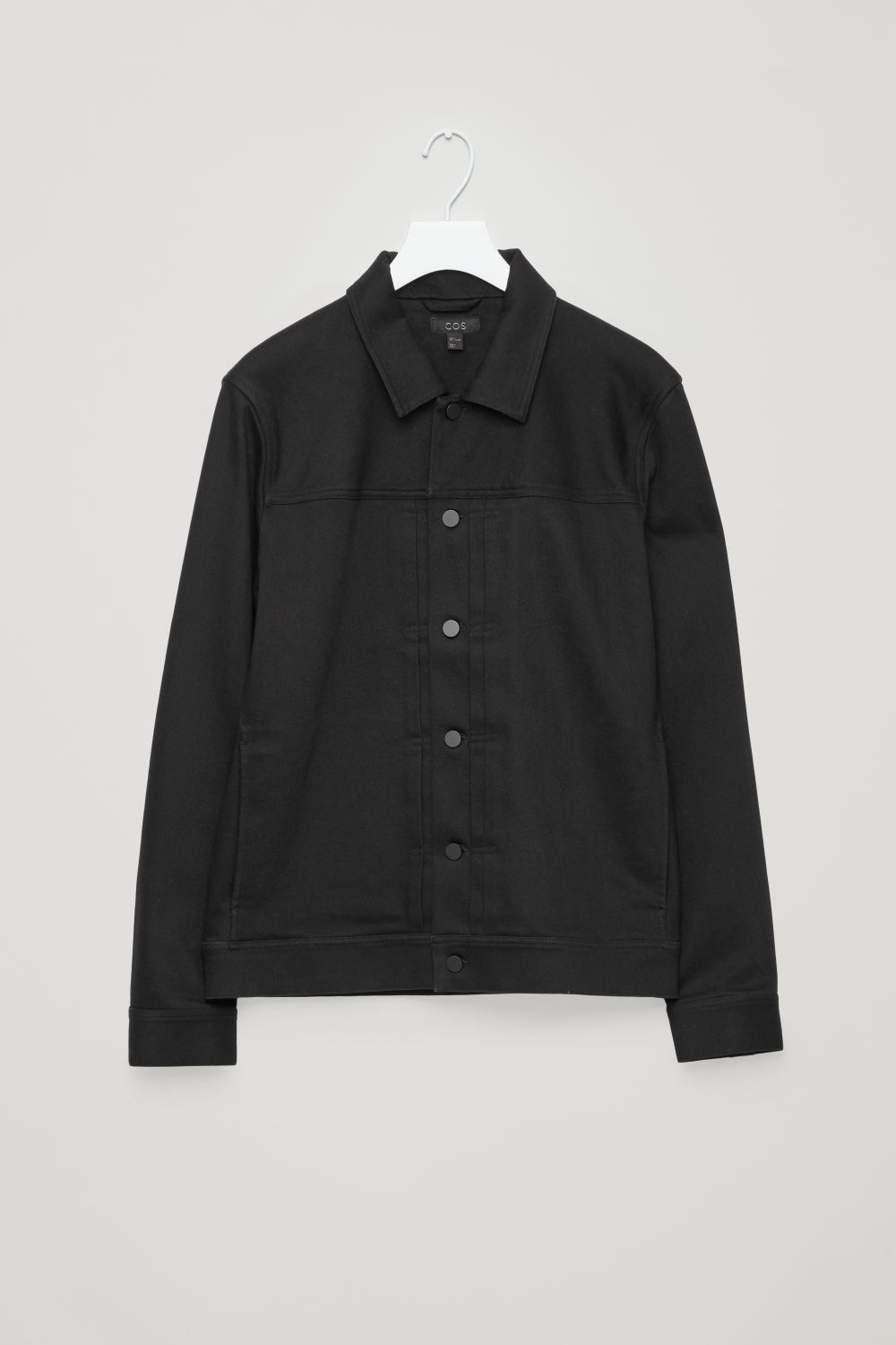 Front image of Cos denim jacket with pleats in black