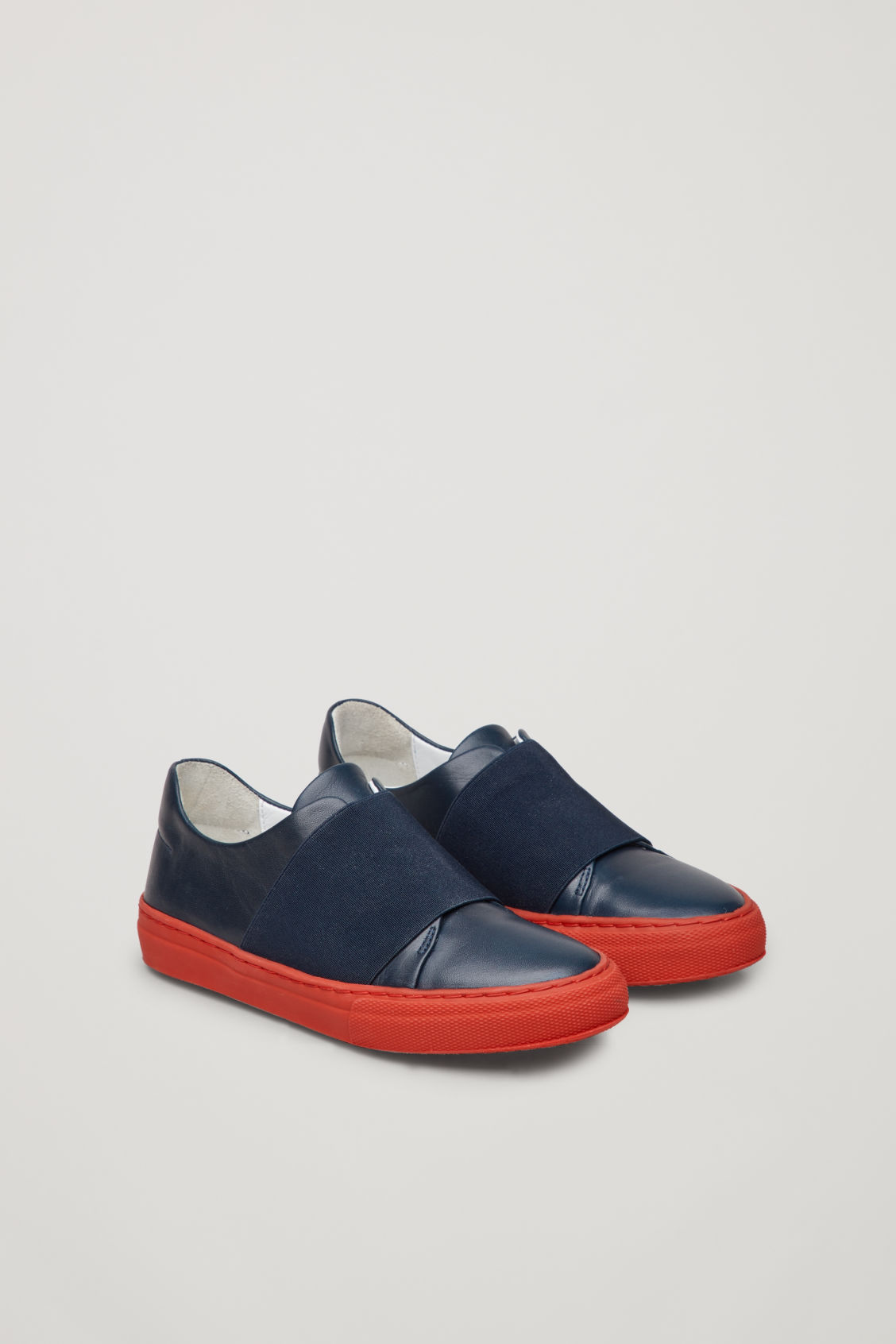 Side image of Cos wrap-over sneakers in blue