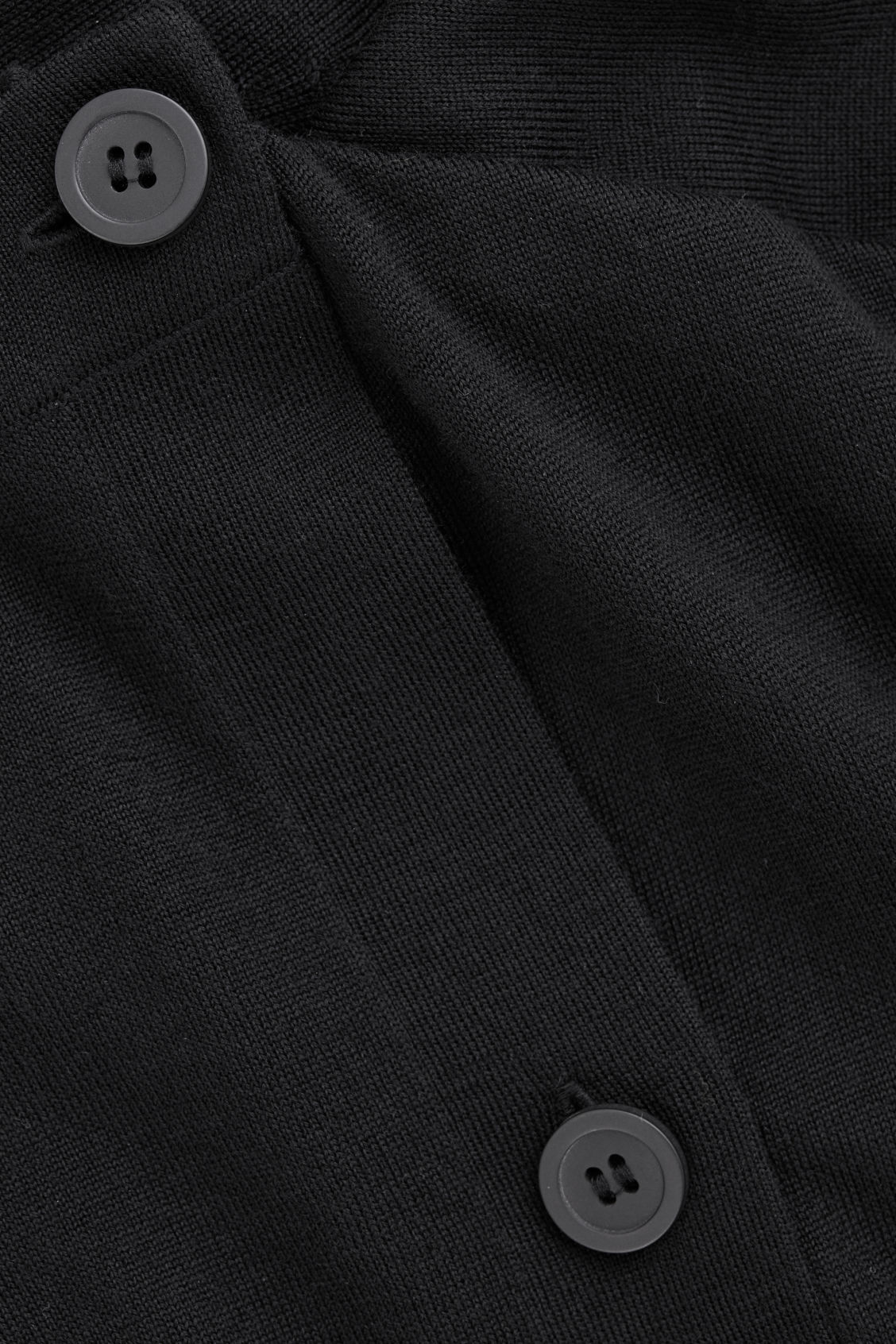 Side image of Cos button-up merino wool cargidan in black