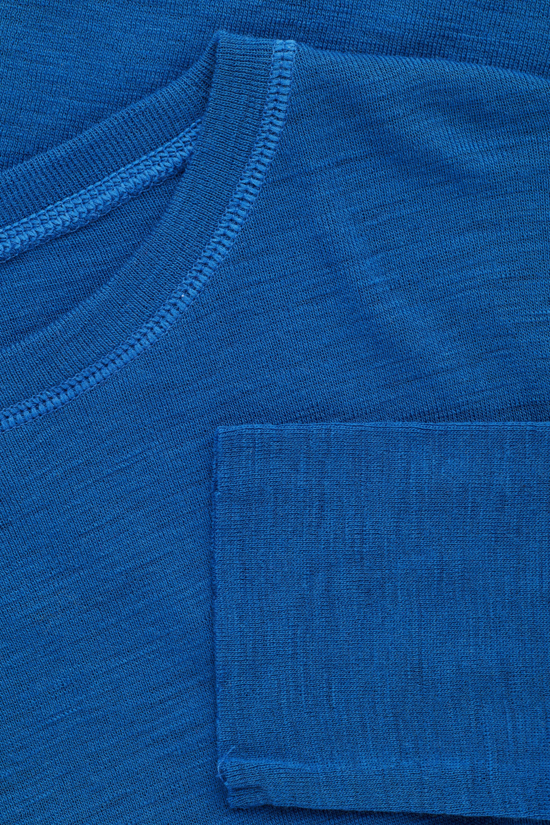 Side image of Cos lightweight  wool jumper in blue