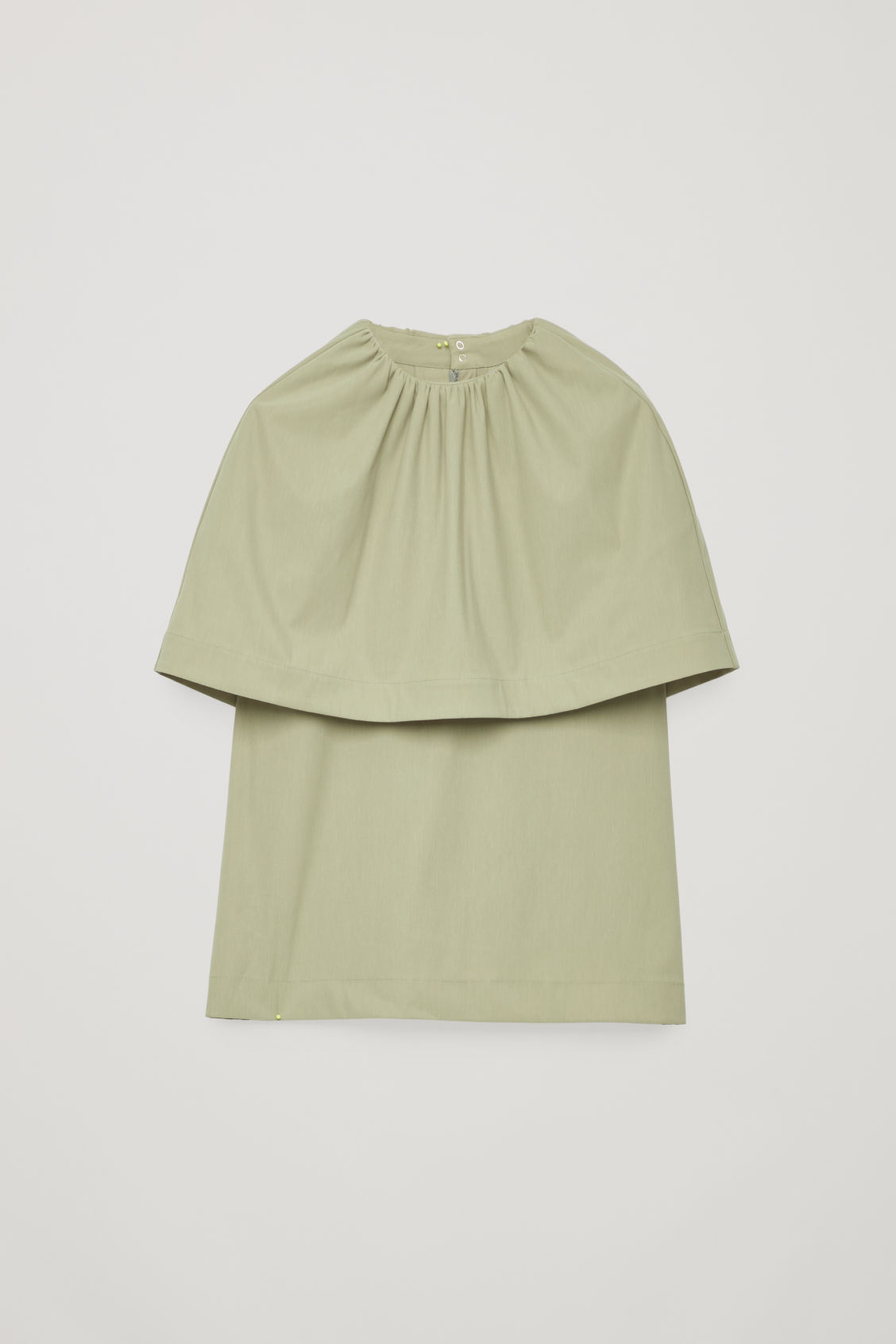Front image of Cos jersey top with cape layer in green