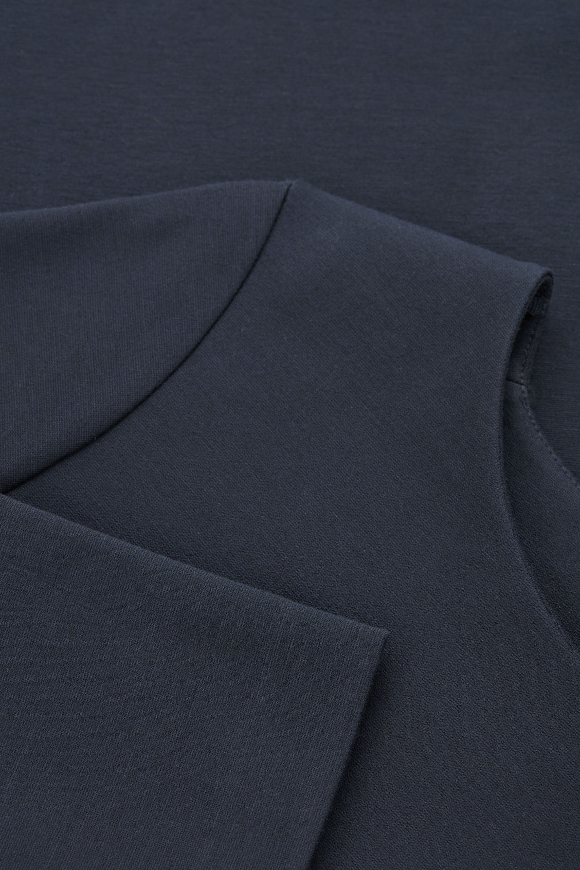 Side image of Cos long-sleeved jersey tunic in blue