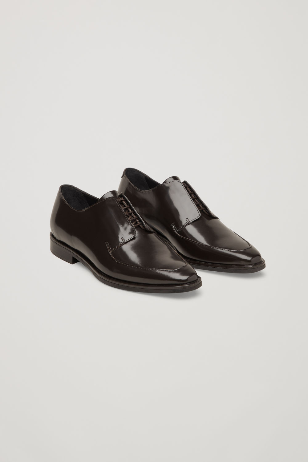 Front image of Cos pointed leather brogues  in burgundy