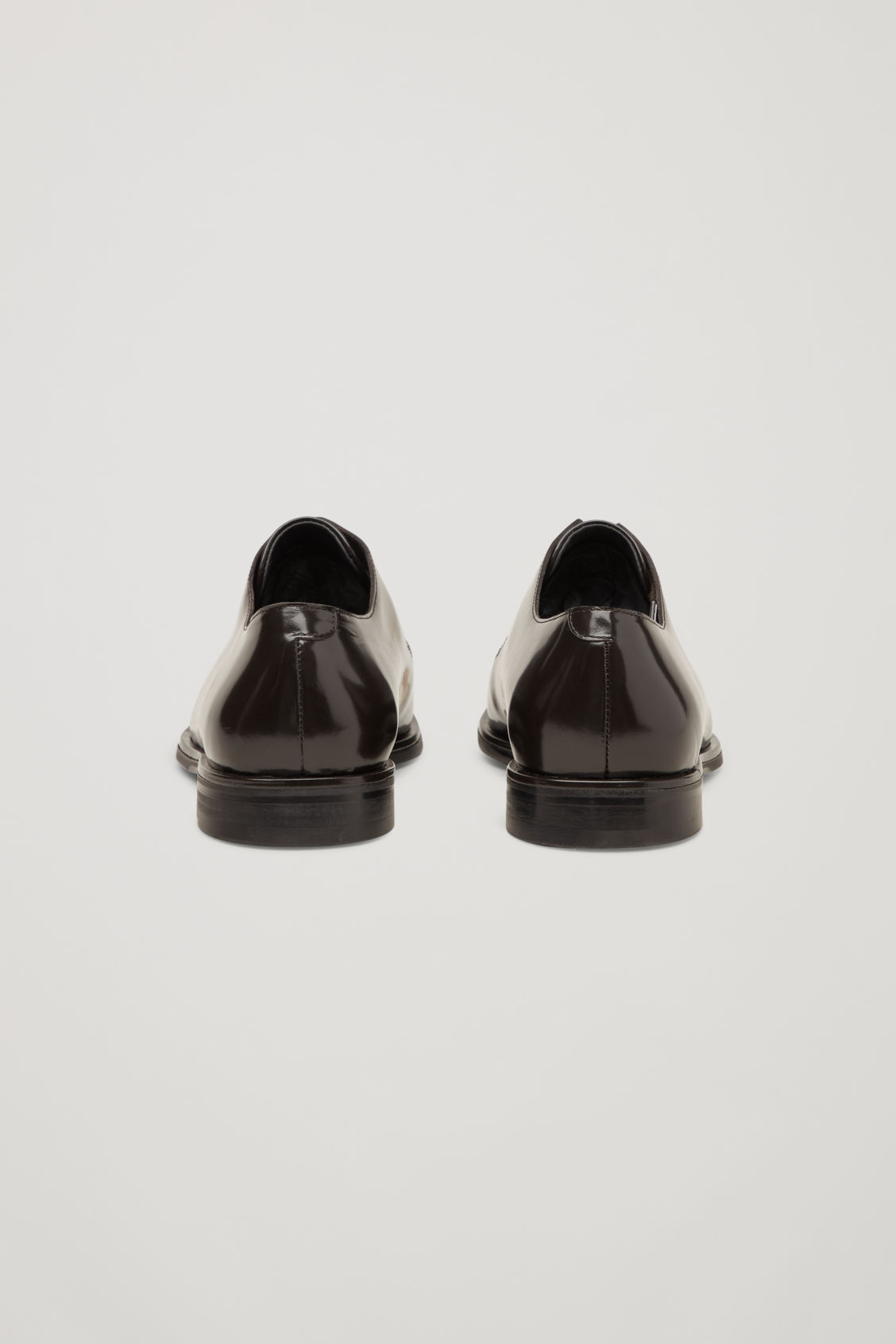 Side image of Cos pointed leather brogues  in burgundy