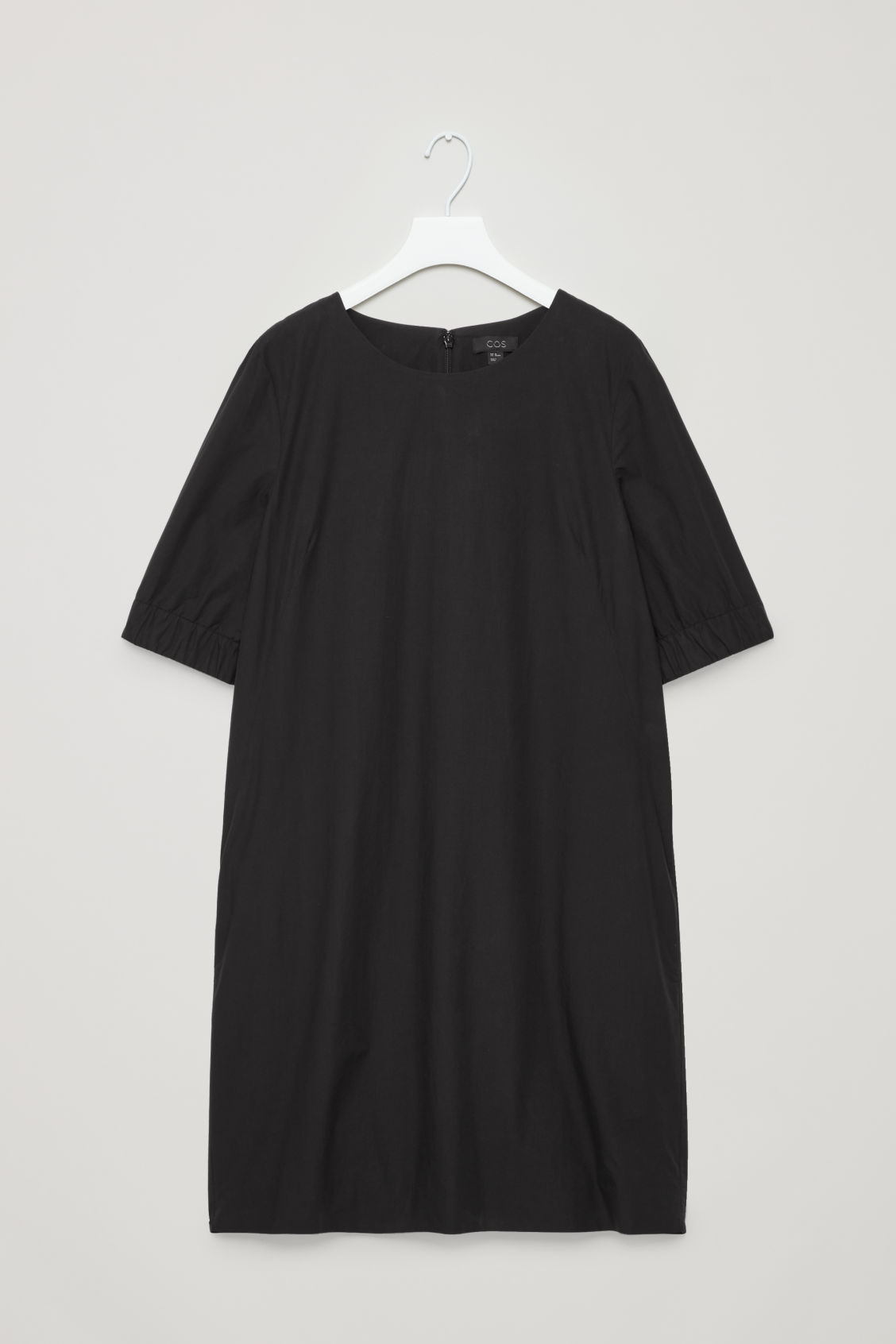 Front image of Cos dress with elasticated sleeves in black